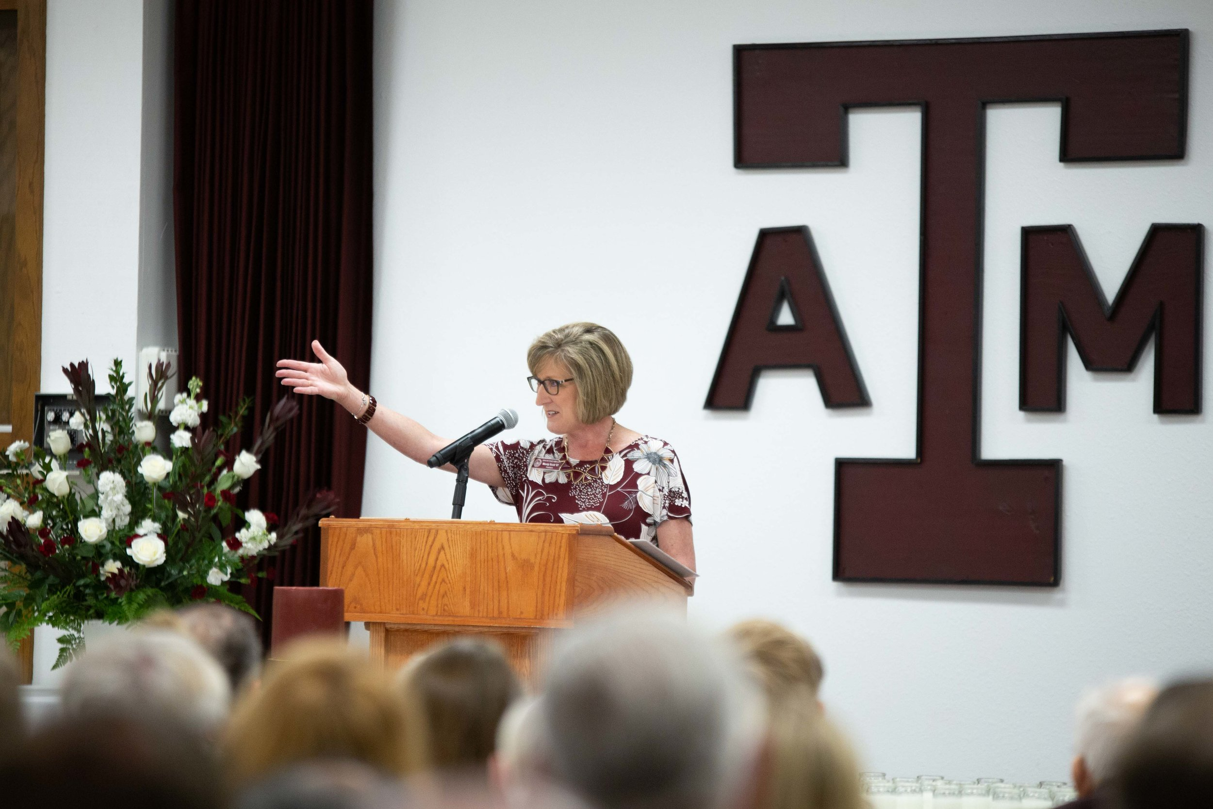 San Antonio A&M Club President, Mandy Scott ('87) addresses the crowd. (Photo by  GA Media Media Productions .)
