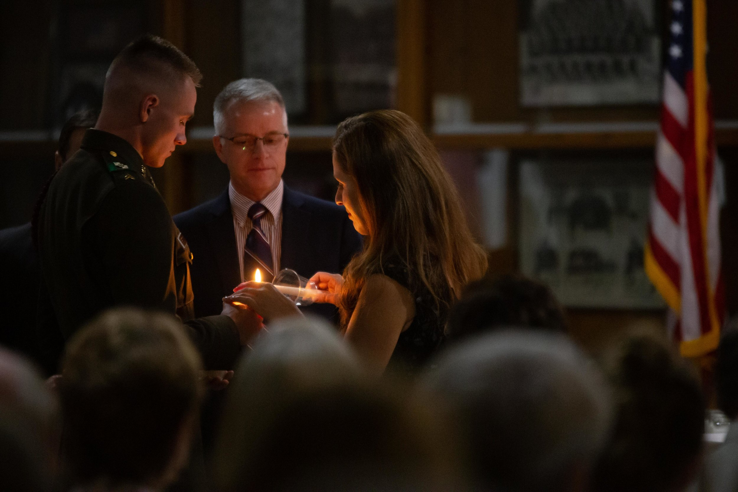 Aggies light candles in honor of the fallen at the Muster. (Photo by  GA Media Media Productions .)