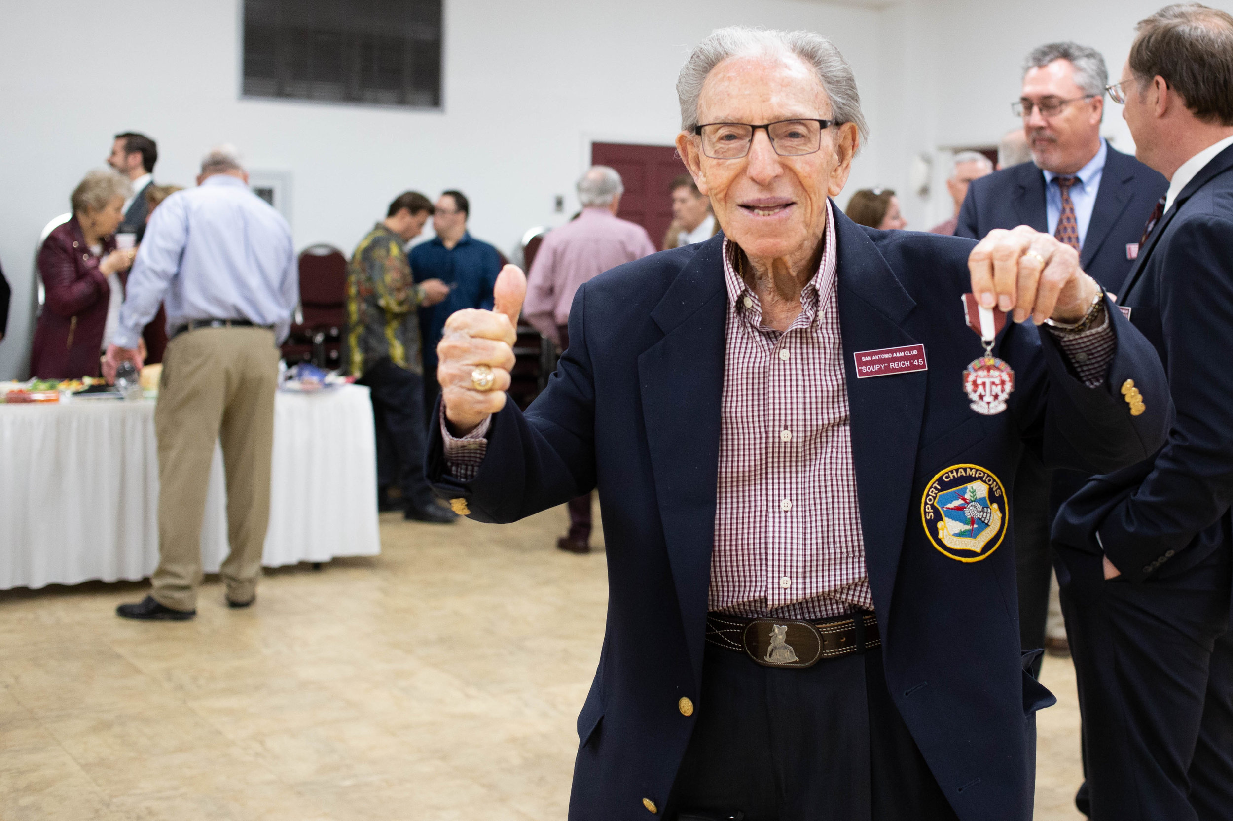 "Harold ""Soupy"" Reich shows off his A&M Fiesta medal. (Photo by  GA Media Media Productions .)"