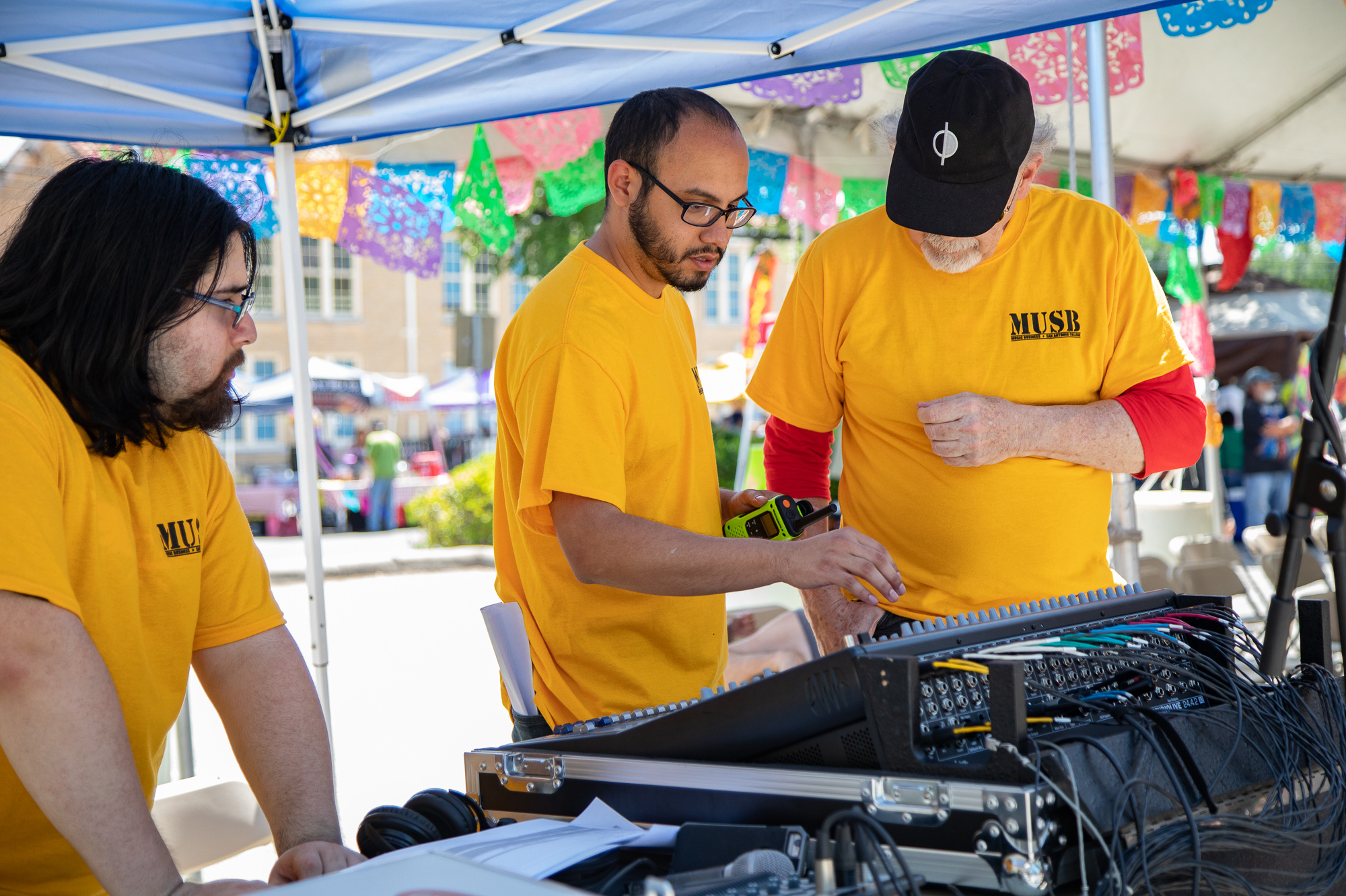 Alumni Kris Perez works with students operating the audio boards at FredStock. (Photo by:  Joel Pena  - Contributing Writer, SA Sentinel)