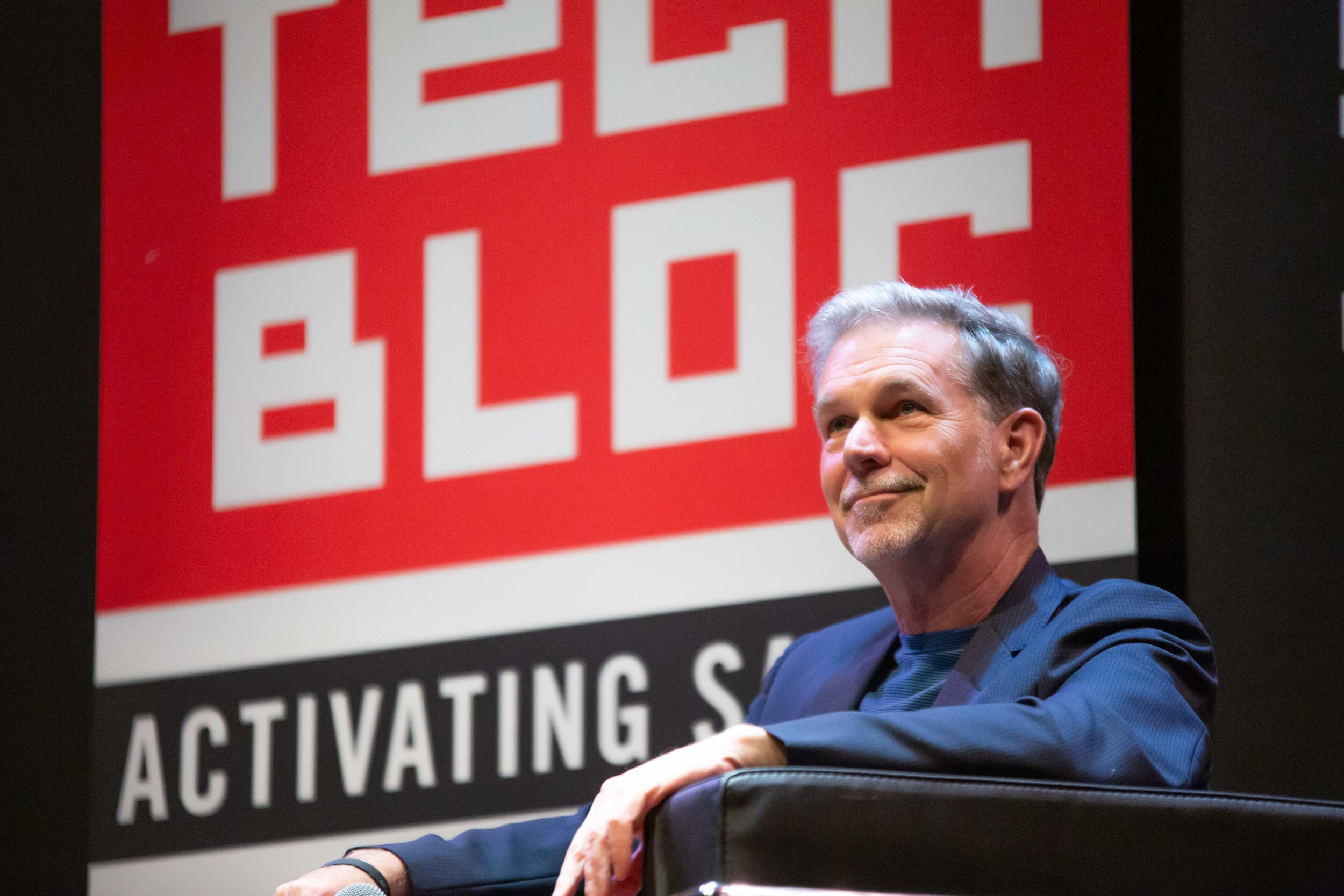 Reed Hastings sits on stage. (Photo by  GA Media Productions .)