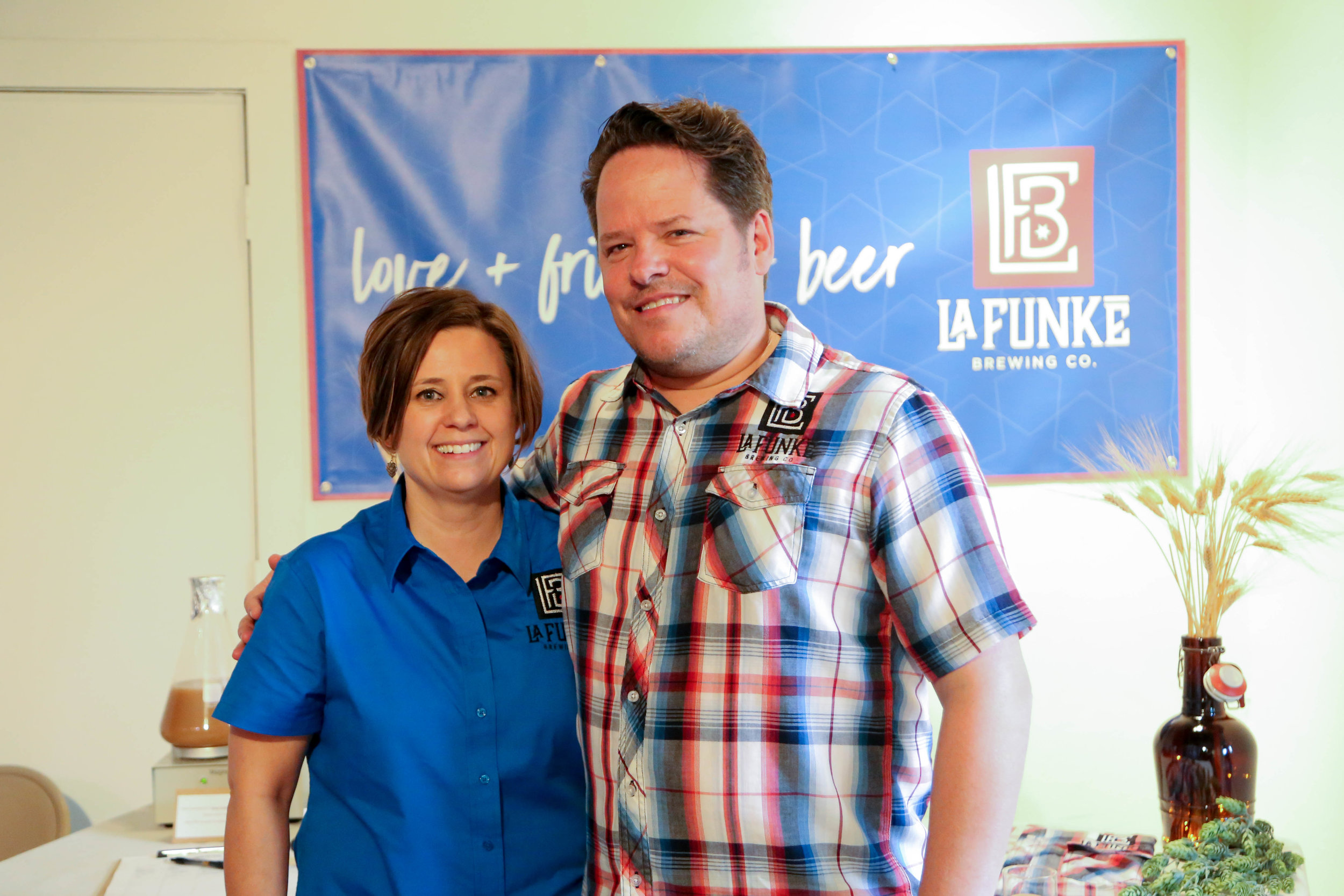 Jennifer Funke and Steve LaFlam stand in front of their booth at Launch SA's Summer Dinner. (Photo by  Jonathan Guajardo  - Editor, SA Sentinel.)