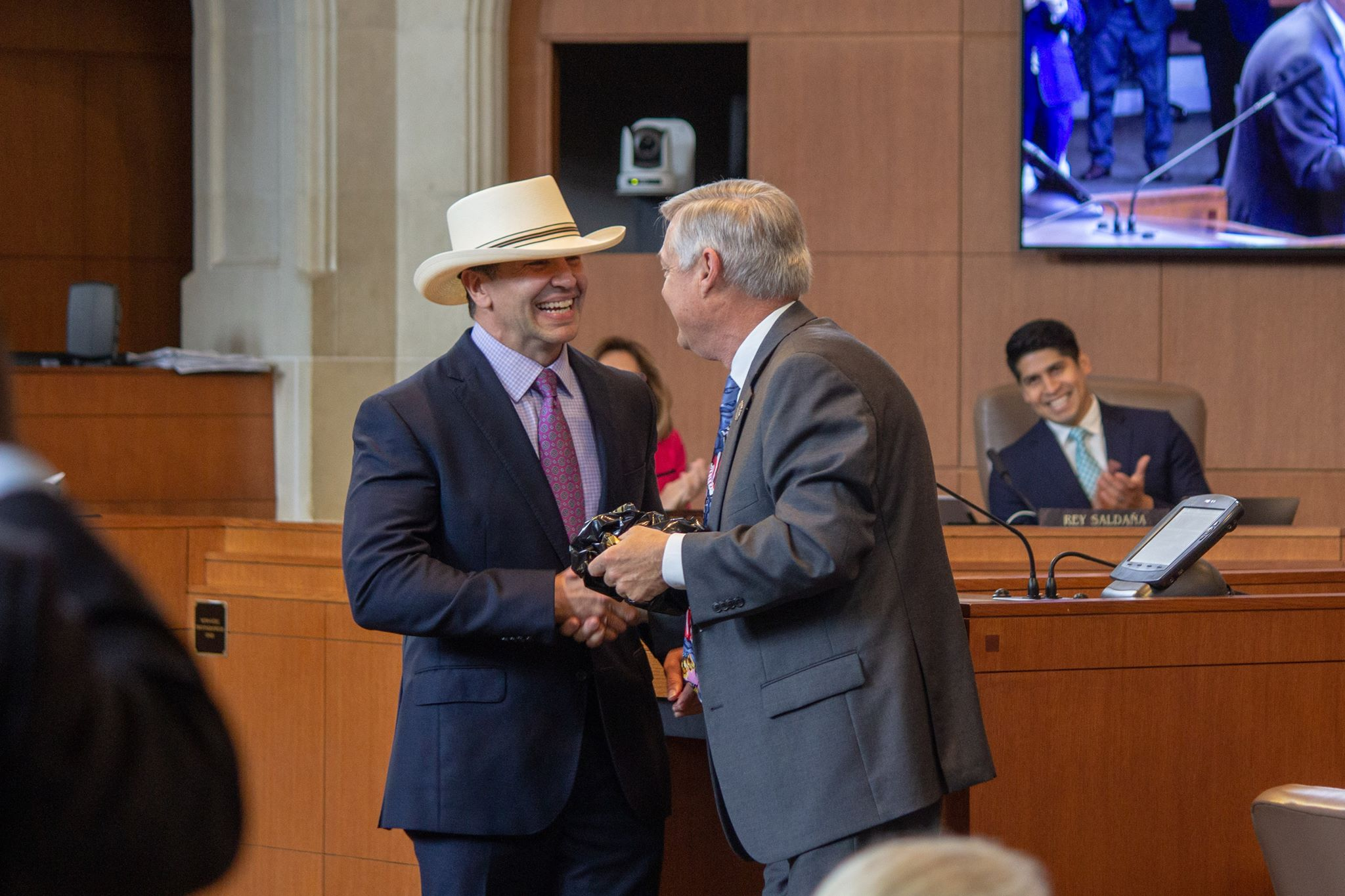Peter Zanoni (left) is honored at the A-Session by Clayton Perry (D10). (Photo by  William Timmerman  - Photographer, The San Antonio Sentinel)