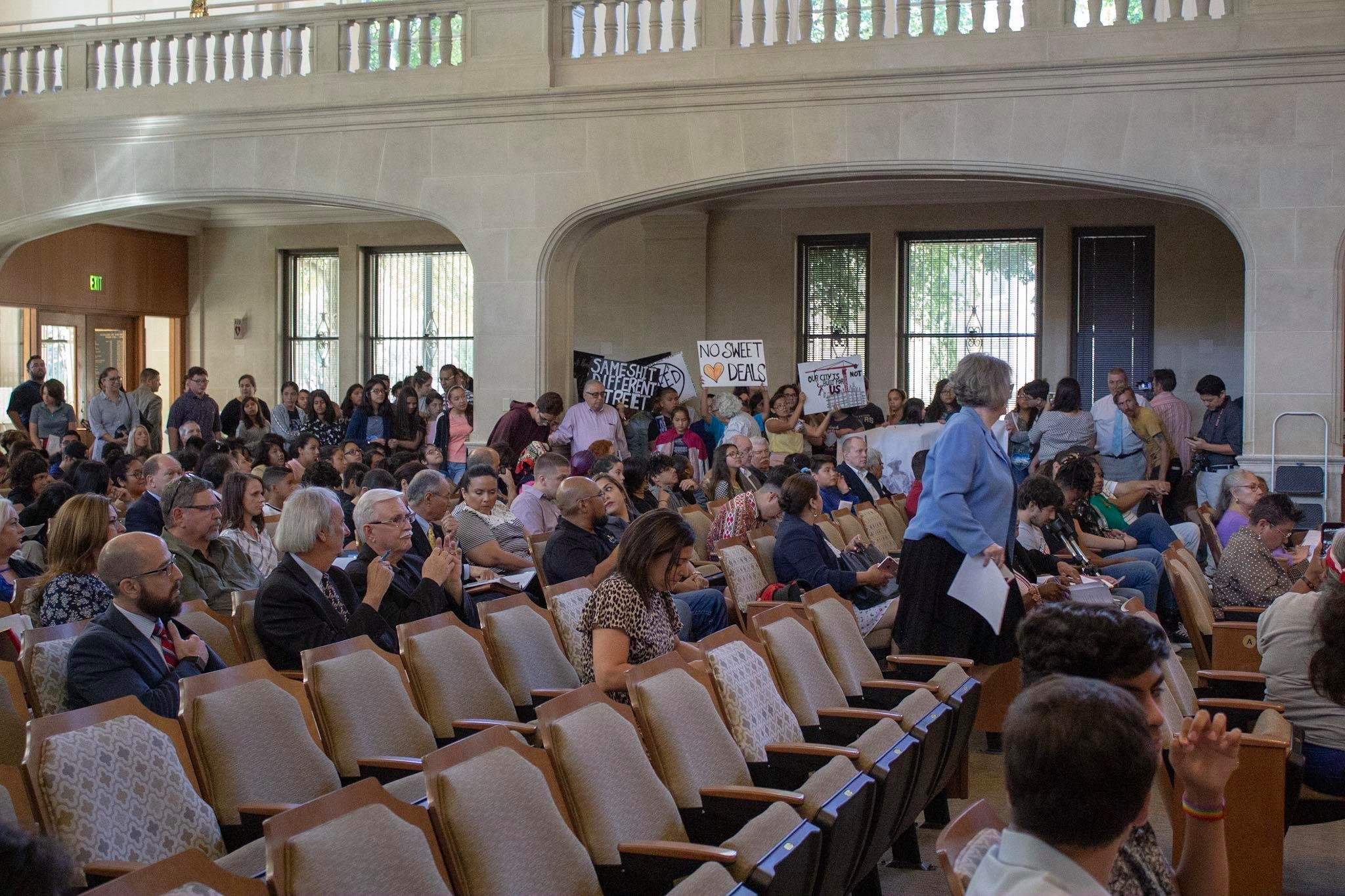 The council chambers were packed with protesters Thursday morning. (Photo by  William Timmerman )