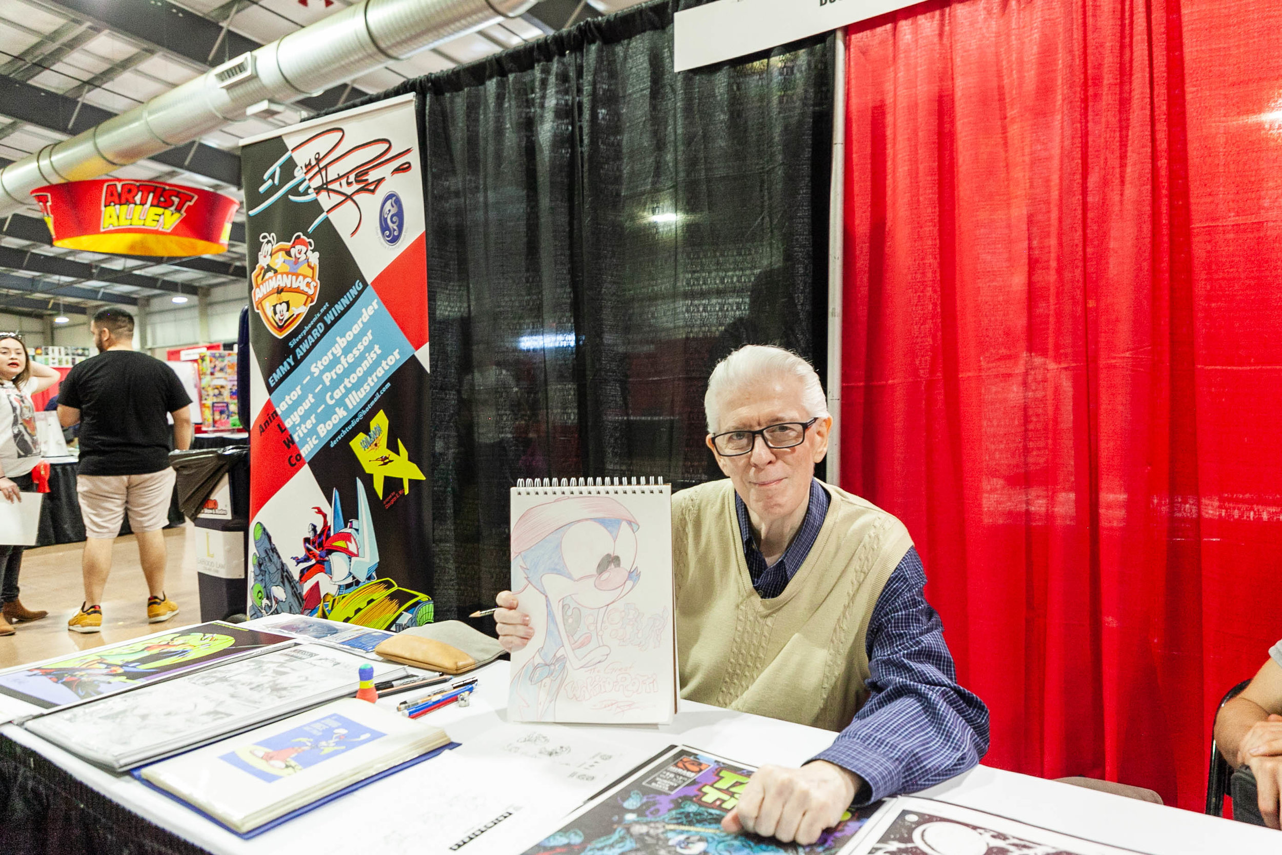 Doug Rice shows off some of his work. (Photo by  Luis Vazquez .)