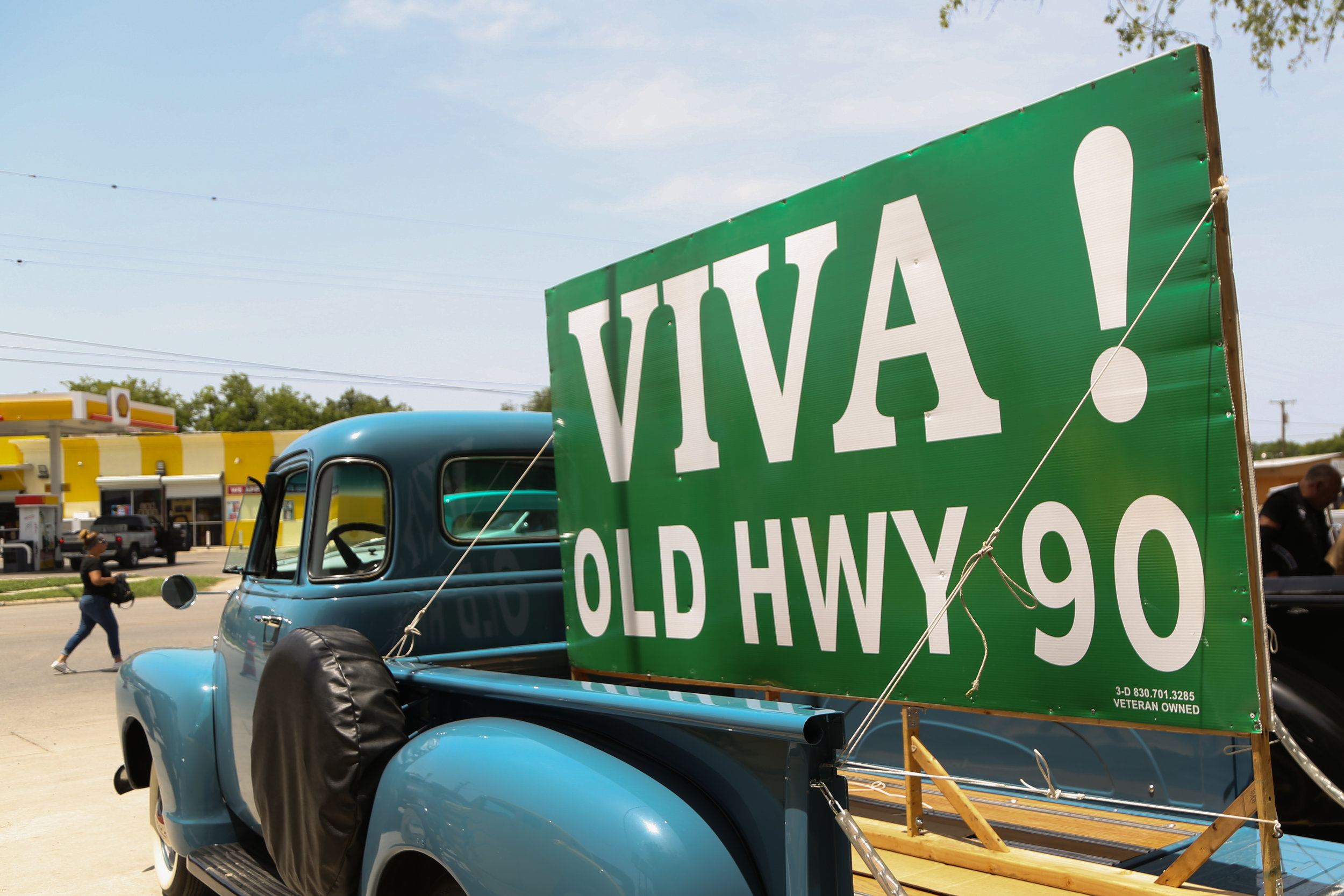 A truck carries a sign in support of Old Highway 90. (Photo by  Jonathan Guajardo .)