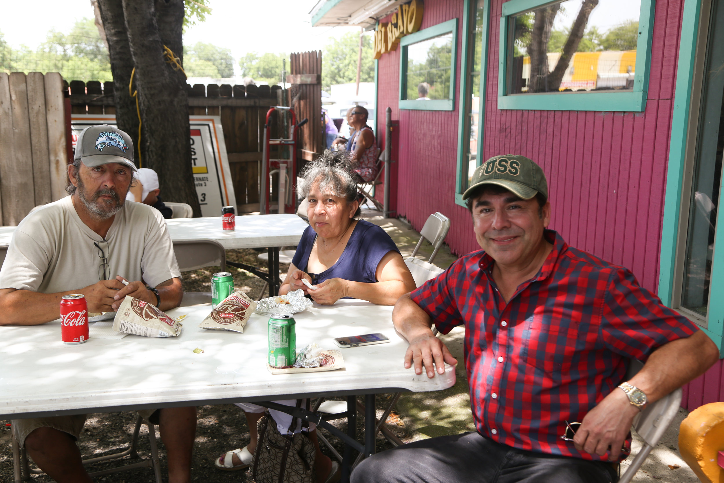 Mauro Garza relaxes with fellow Brockhouse supporters. (Photo by  Jonathan Guajardo .)