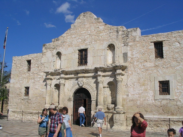 Tourists file in and out of the Alamo in San Antonio, Texas. (Photo by  Ken Lund )