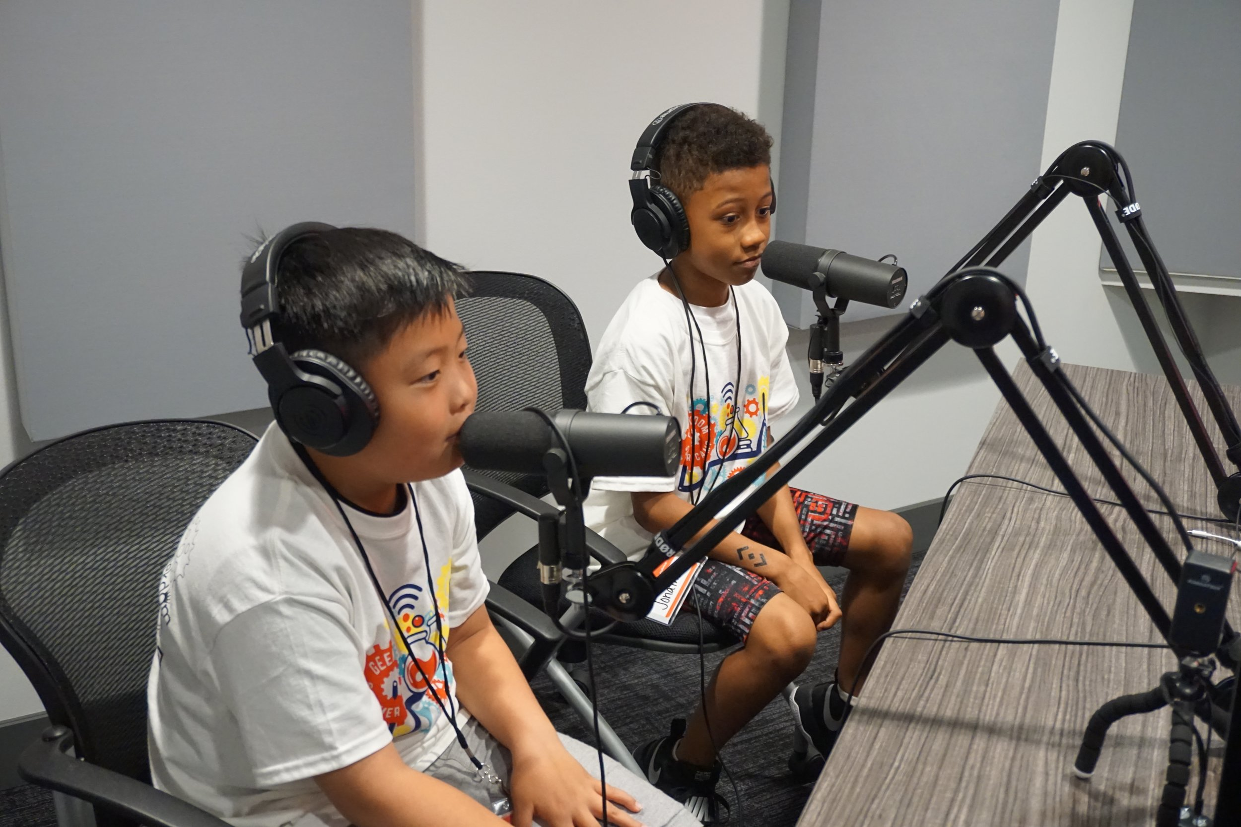 Children check out the podcast studio at Geekdom. (Photo courtesy Geekdom STEAM Summer Camp.)