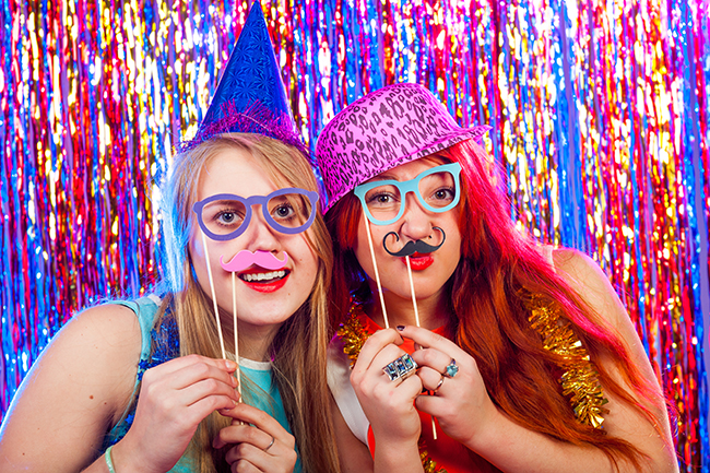 Young nice girls have fun on a dance party.jpg