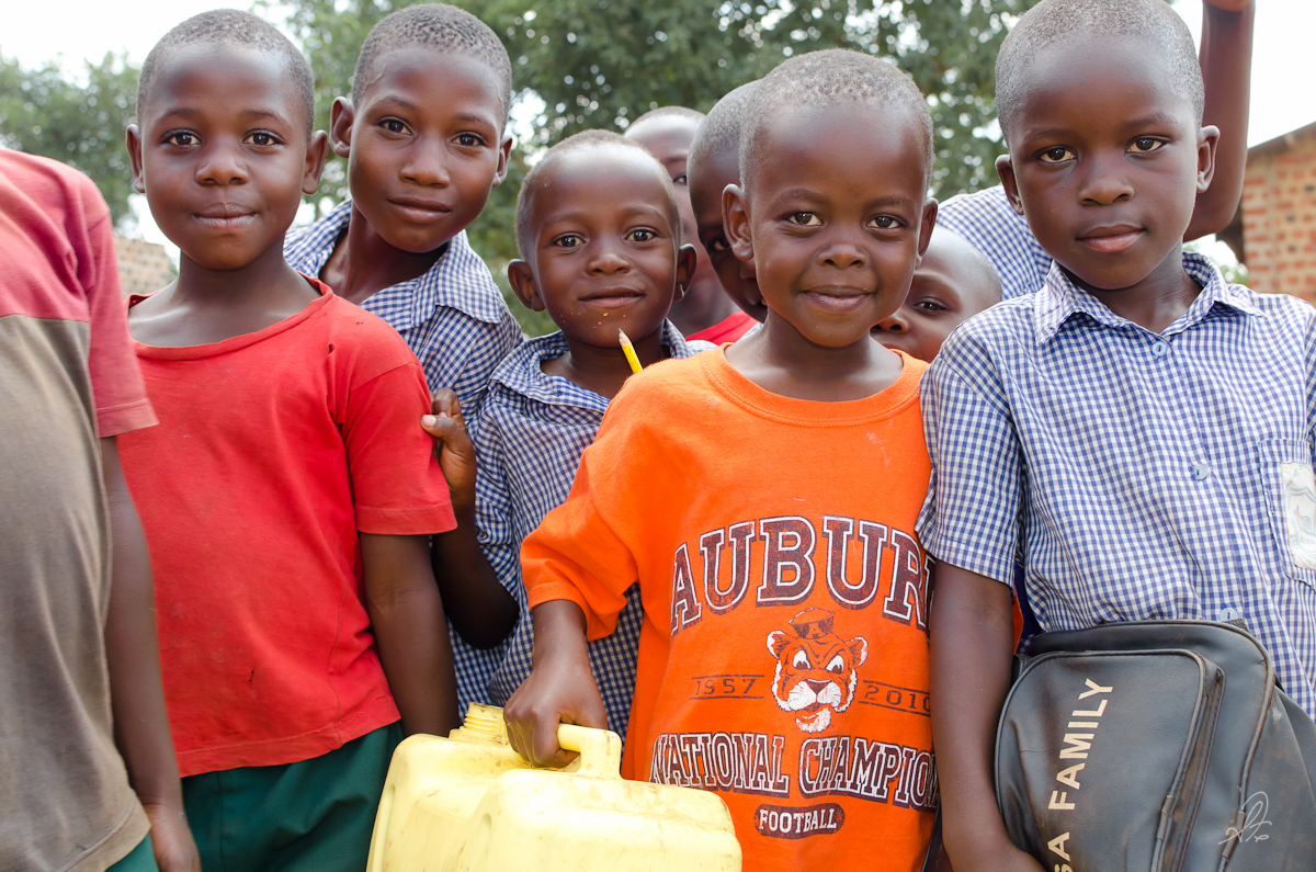 Kids in Buloba with Water Jugs