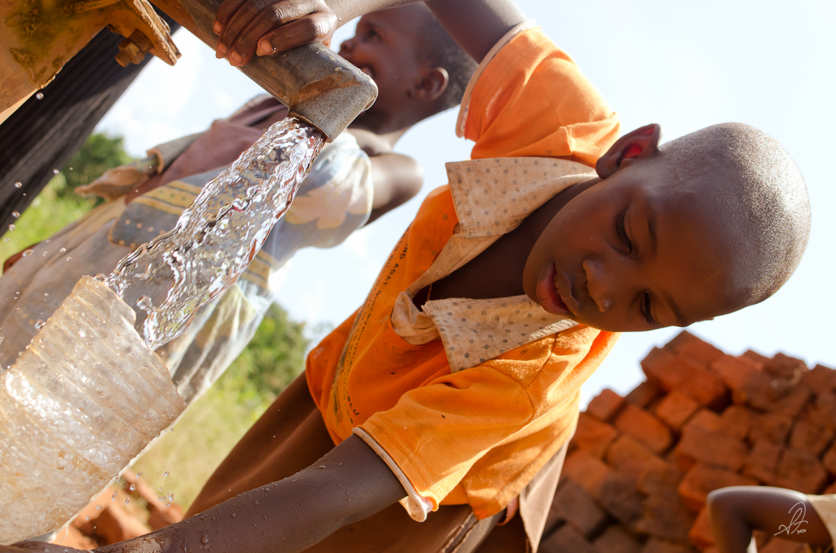 Girl Collects Water from Deep Bore Well