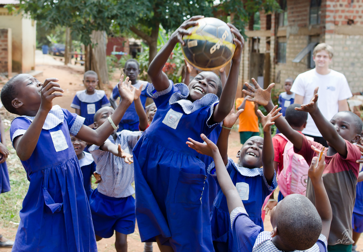Kids in Buloba School Catch Soccer Ball