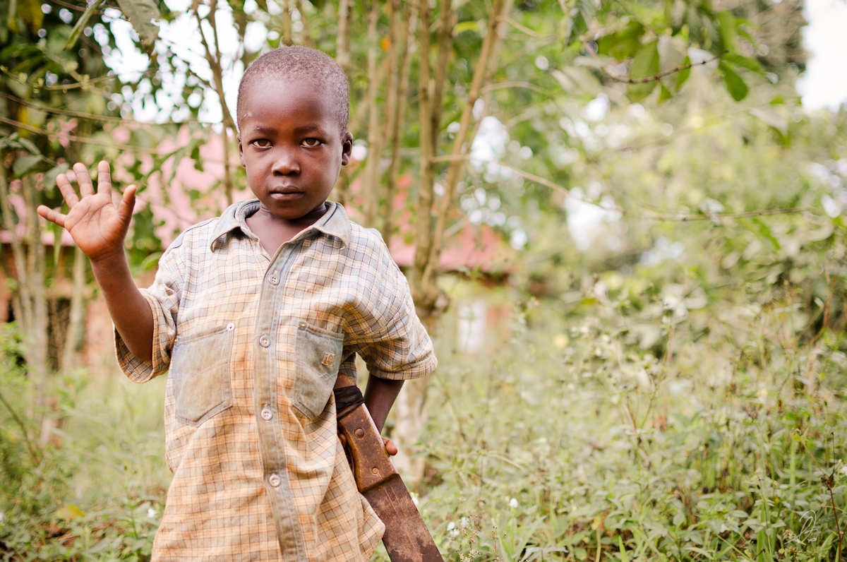 Ugandan Boy Holds a Machete