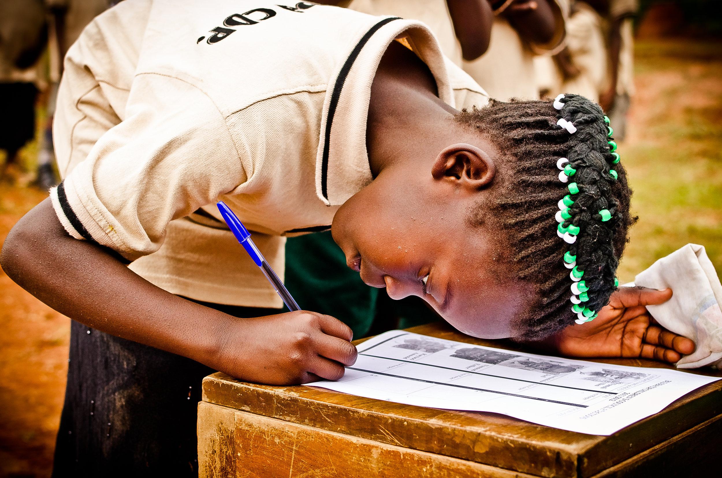 Ugandan Girl Places Her Vote