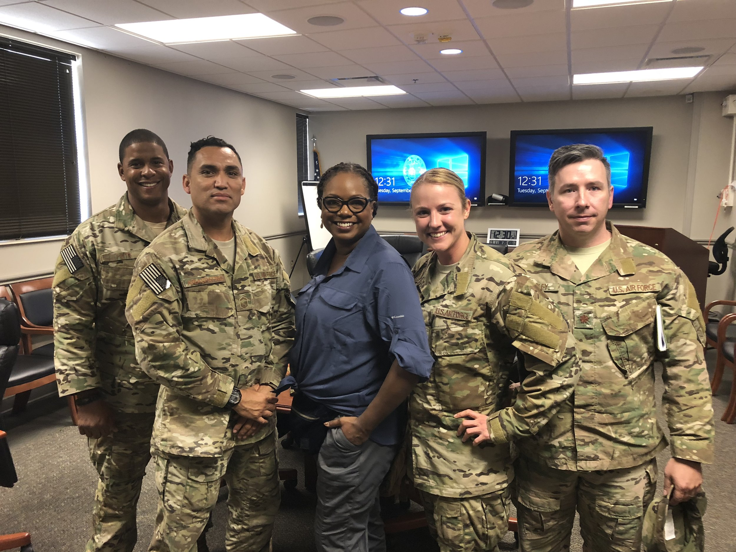Host Wendy Calhoun with Regan and members of the 720th Special Operations Surgical Team at AFSOC, Hurlburt Field, FL.