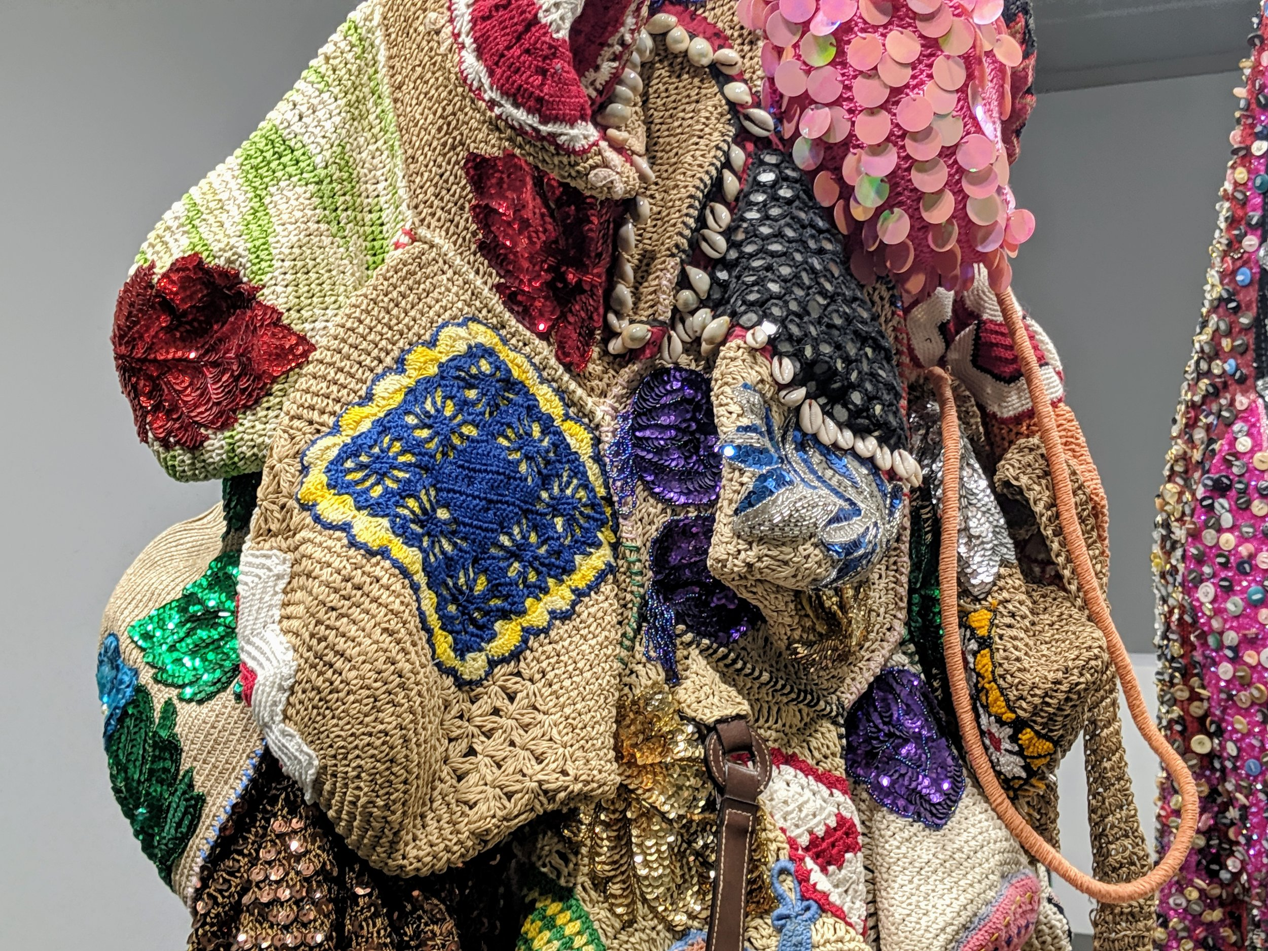 "Close-up of an assemblage of ""hobo bags"" from a Soundsuit"