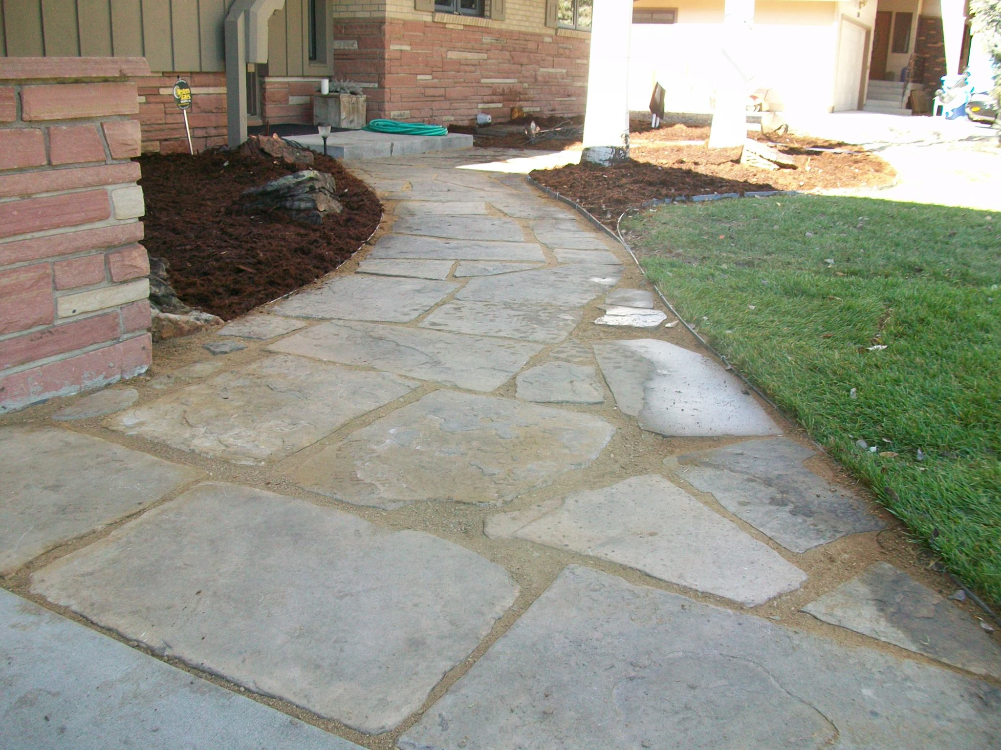 Buff flagstone path to front door.