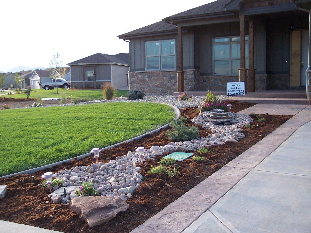 Tri City creatively designed and installed this landscape masterpiece, which won the Parade of Homes in 2014. Titus created the cobble stone stream during on-site changes to the contract during install.