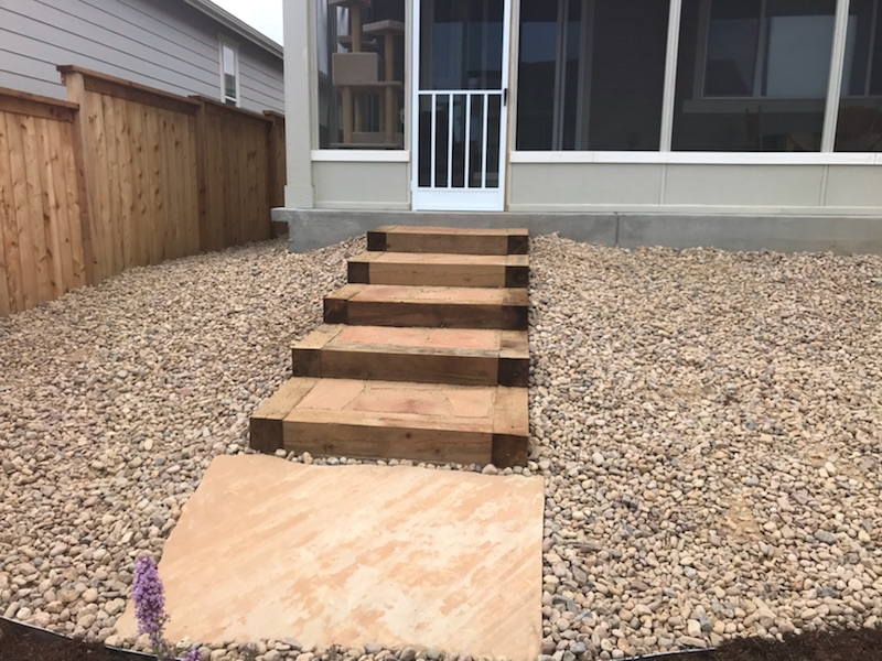 6x6 timber steps with flagstone inset landings.