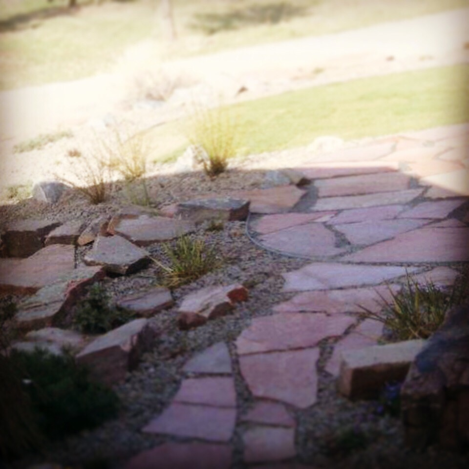 Creative view of a flagstone pathway install.
