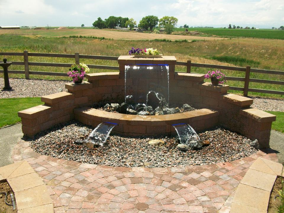 Beautiful fountain and planters created out of Versa Lok blocks and Belgard paver patio.