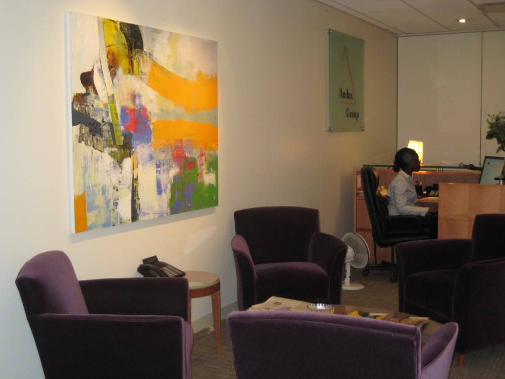 Audax Group - Black and white photography had previously dominated this corporate firm's reception area, creating a drab, monochromatric atmosphere. A colorful fine art abstract oil painting replaced the photography, bringing a revitalized energy to the space.