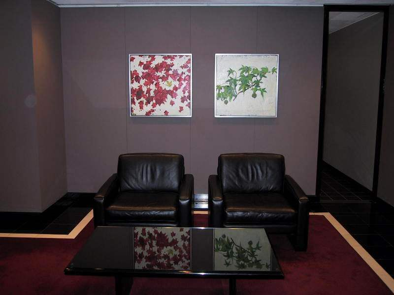 ALLIANCE BERNSTEIN - In order to soften the masculinity of the dark walls and leather furnishings of the corporate reception area, we installed two complementary fine art floral oil paintings.