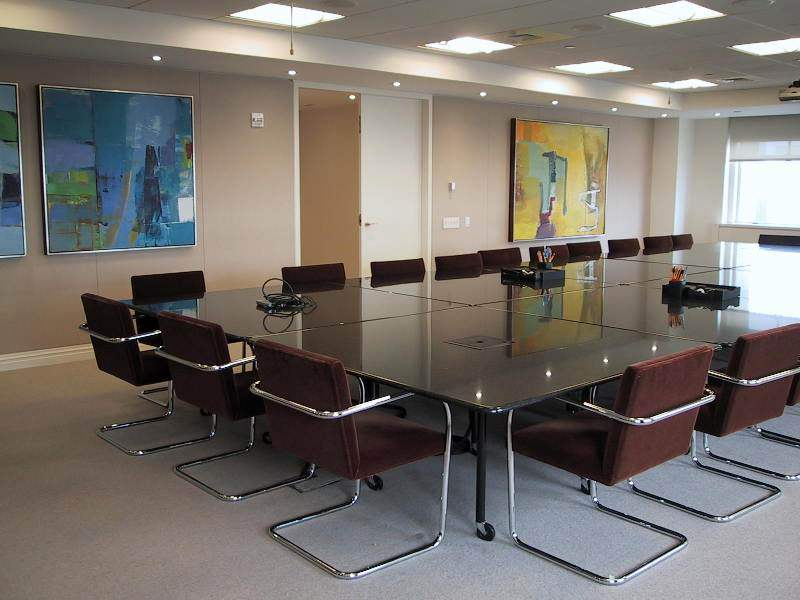 Baker Botts - This corporate client wanted to add energy to a very large, bleak boardroom with considerable amounts of wall space. Multiple bold fine art abstract oil paintings were placed in succession along the longest wall to liven up the large room.