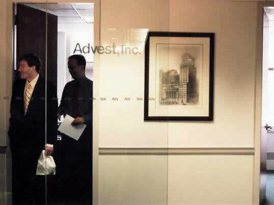 ADVEST INC. - In order to create an artistic focal point that would show stability without appearing too decorative, we placed a traditional architectural fine art print of the New York Stock Exchange between two conference rooms.