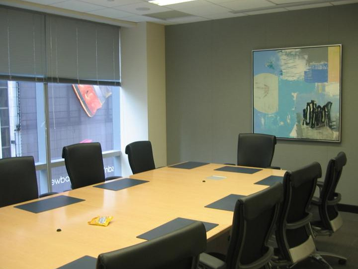 FTI CONSULTING - In order to break up the monotony of a long, bare conference room, we placed a colorfully energetic fine art abstract oil painting at the end of the conference table to create a focal point.