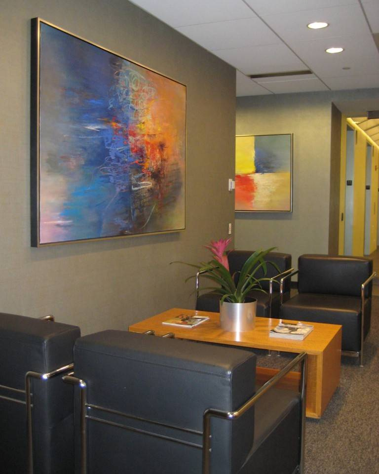 FTI Consulting - We created continuity within this corporate office by strategically placing two complimentary fine art pieces on perpendicular walls. This helped guide people from the reception area into the main office and set the tone for the fine art in the remainder of the corporate office space.