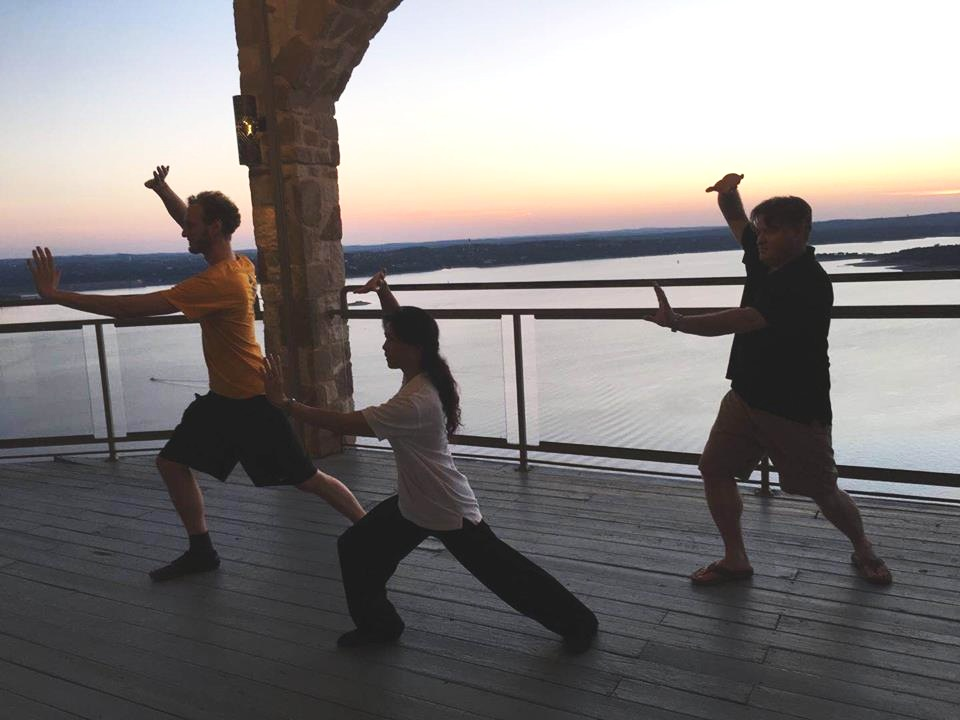 Practicing Tai Chi on the shores of Lake Travis