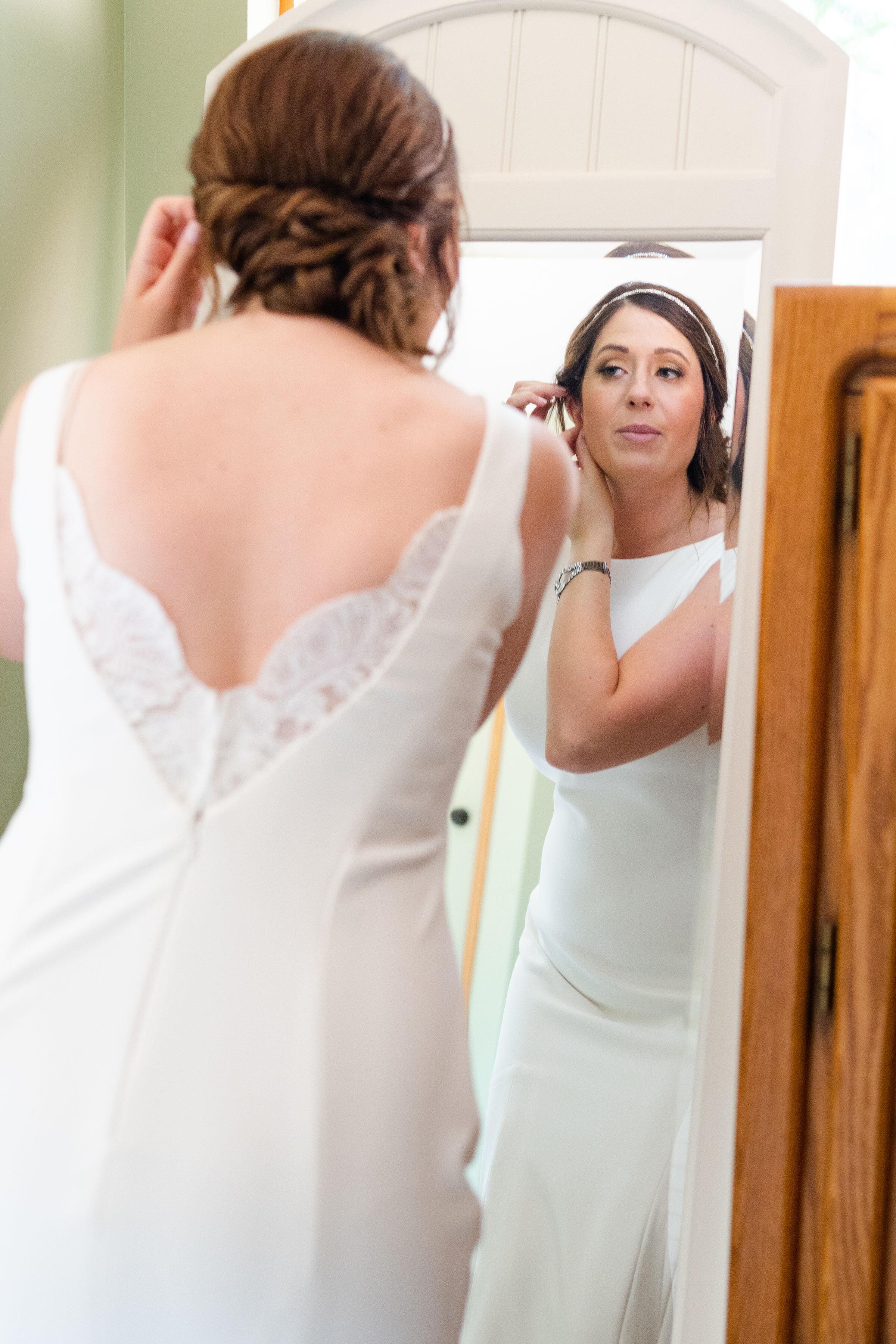 bride looking in mirror.jpg