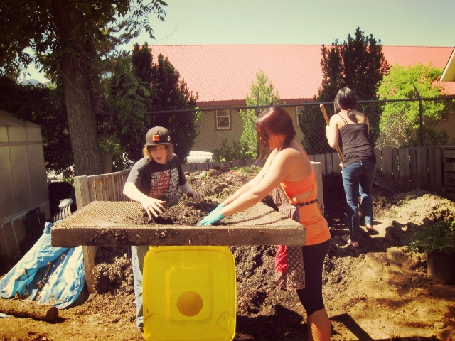 Youth Sifting Soil