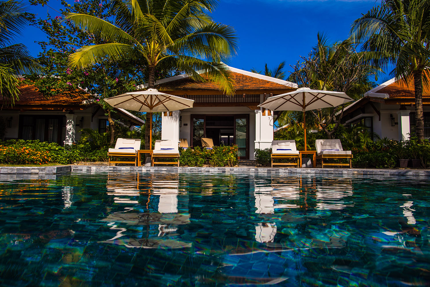 Pool View Villa - With the private terrace just steps from the turquoise tri-level swimming pool, our beautiful Pool View Villas are the perfect choice for those who favour endless days relaxing poolside.