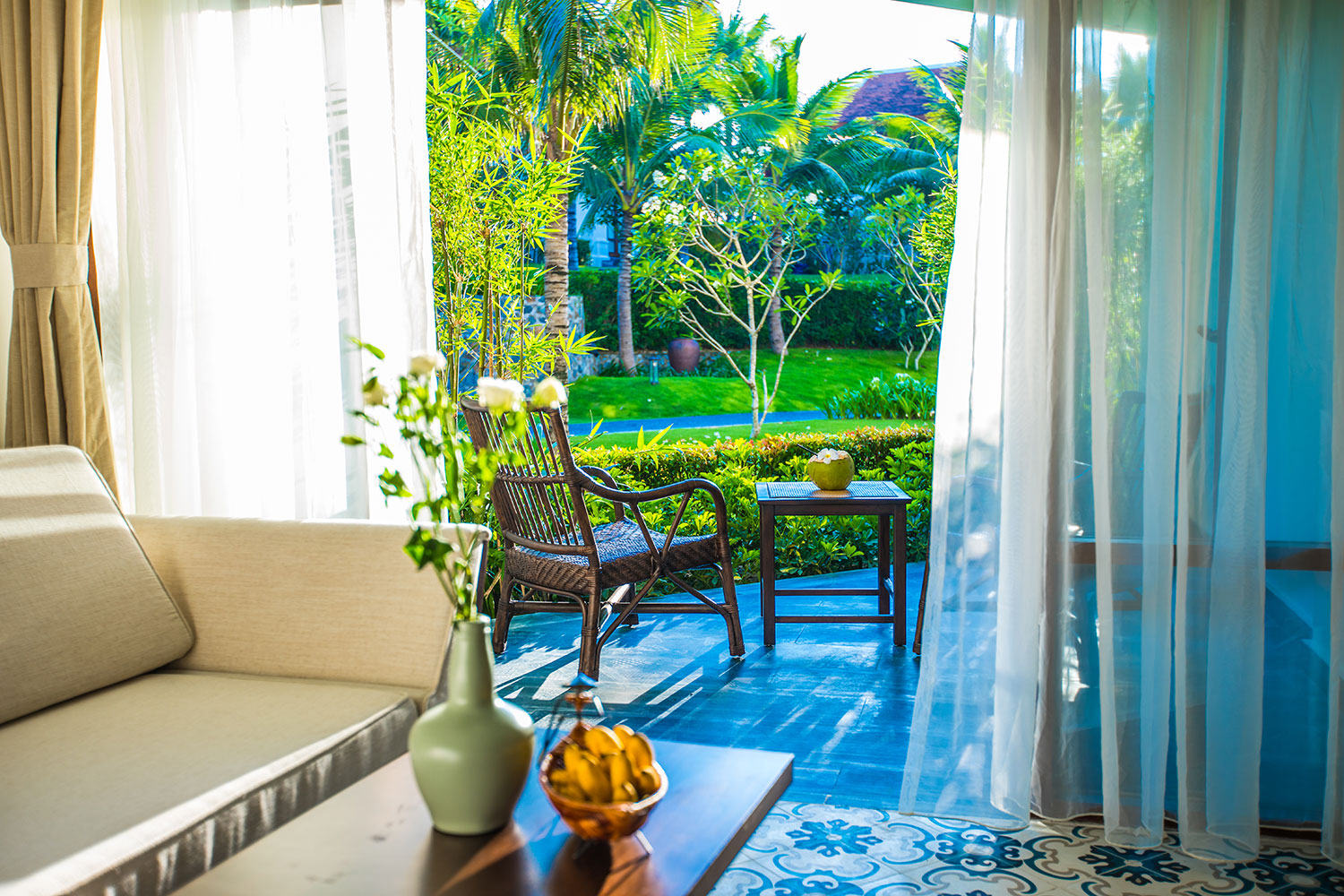 Balcony Garden View Room - With views of lush tropical gardens, our Balcony Garden View Rooms combine The Anam's signature architectural style of the Indochine era with modern luxury.
