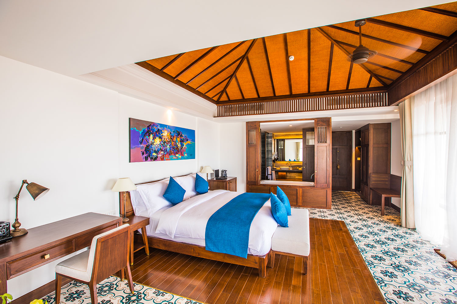 Terrace Garden View Suite - The incredibly spacious 72 sqm Terrace Garden View Suites enjoy a private balcony with stunning views across the tropical gardens, and a gorgeous design that reflects the resort's storied indochine charm without compromising on modern luxury.
