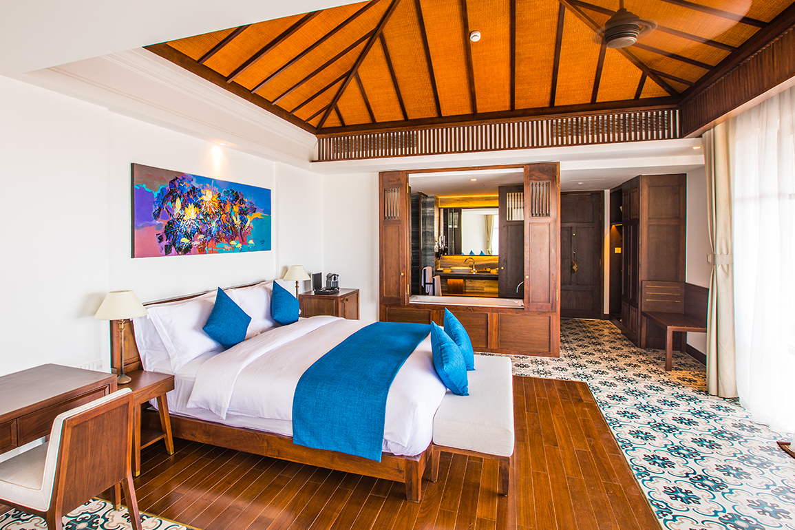 Rooms - The Anam Deluxe Room Collection features 136 rooms in the five-floor building and the quarter duplex, all with access to a garden or balcony. Many of the rooms afford open views of the sparkling sea and verdant surrounds.