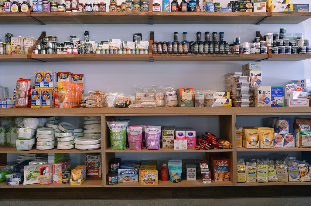 Custom Shelving at Copperlane, Tahoe. Wooden shelved with colorful food packaging