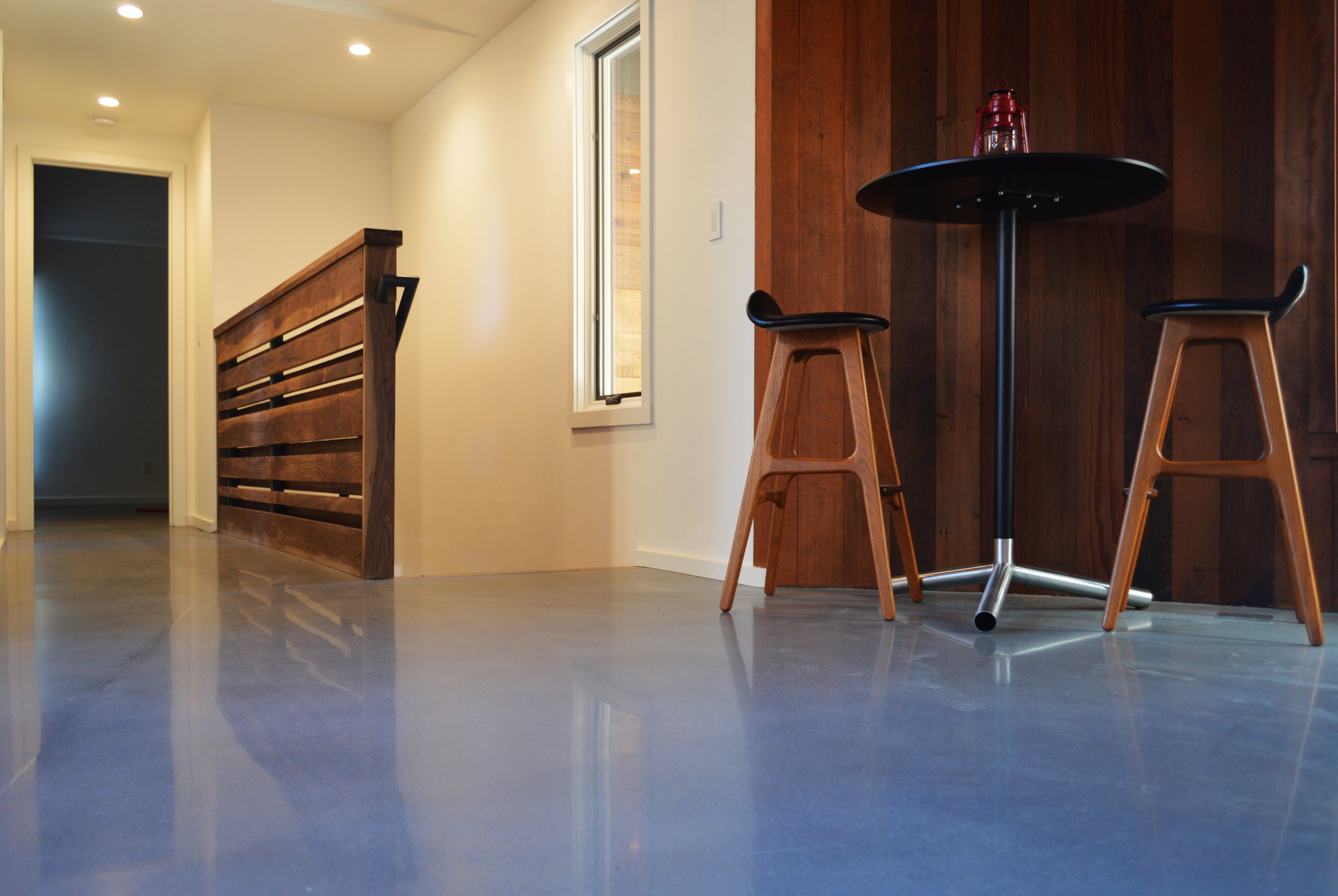 Tru Overlay flooring in a bright and open residential hallway