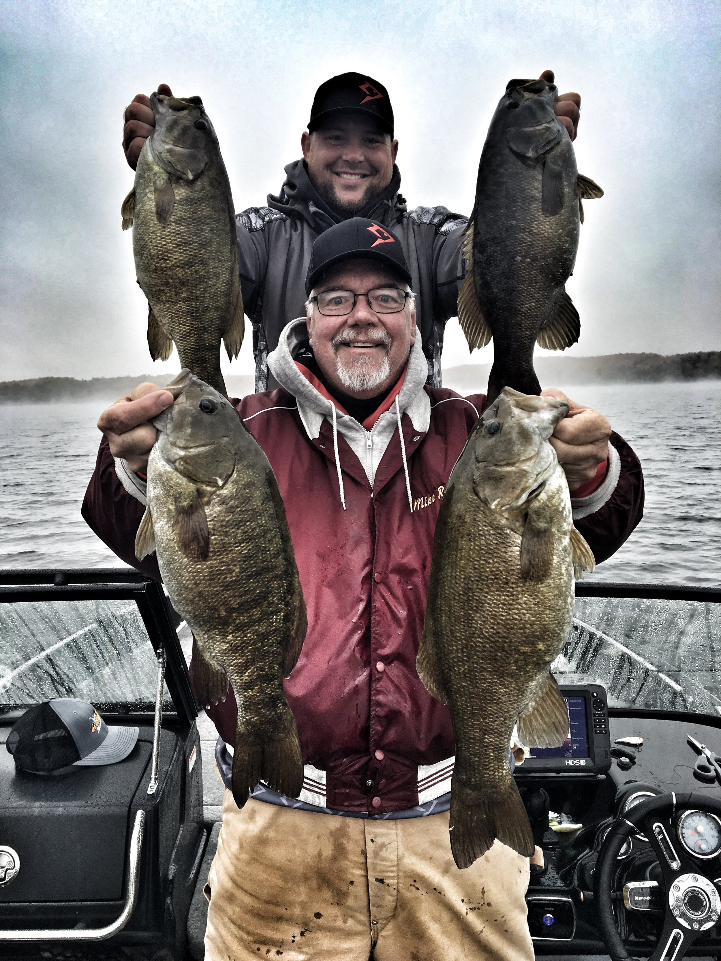 When was the last time, or any time for that matter, that you saw four 5-pound smallmouth bass in one photo? Jason Brenic and Mike Roux.  (Photo by Jason Drewa)