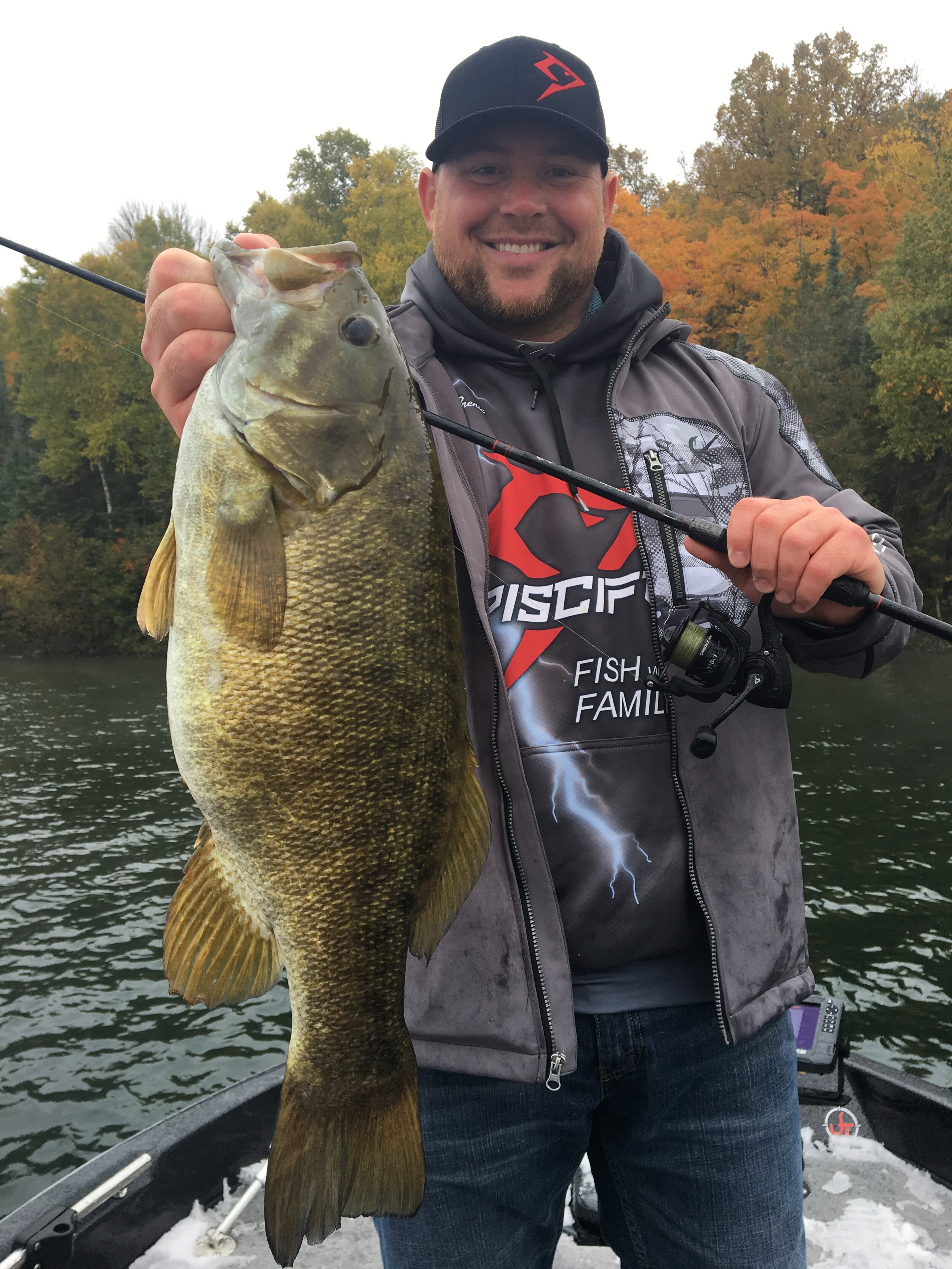 PISCIFUN American Director Jason Brenic with well scouted trophy smallmouth.  (Photo by Mike Roux)