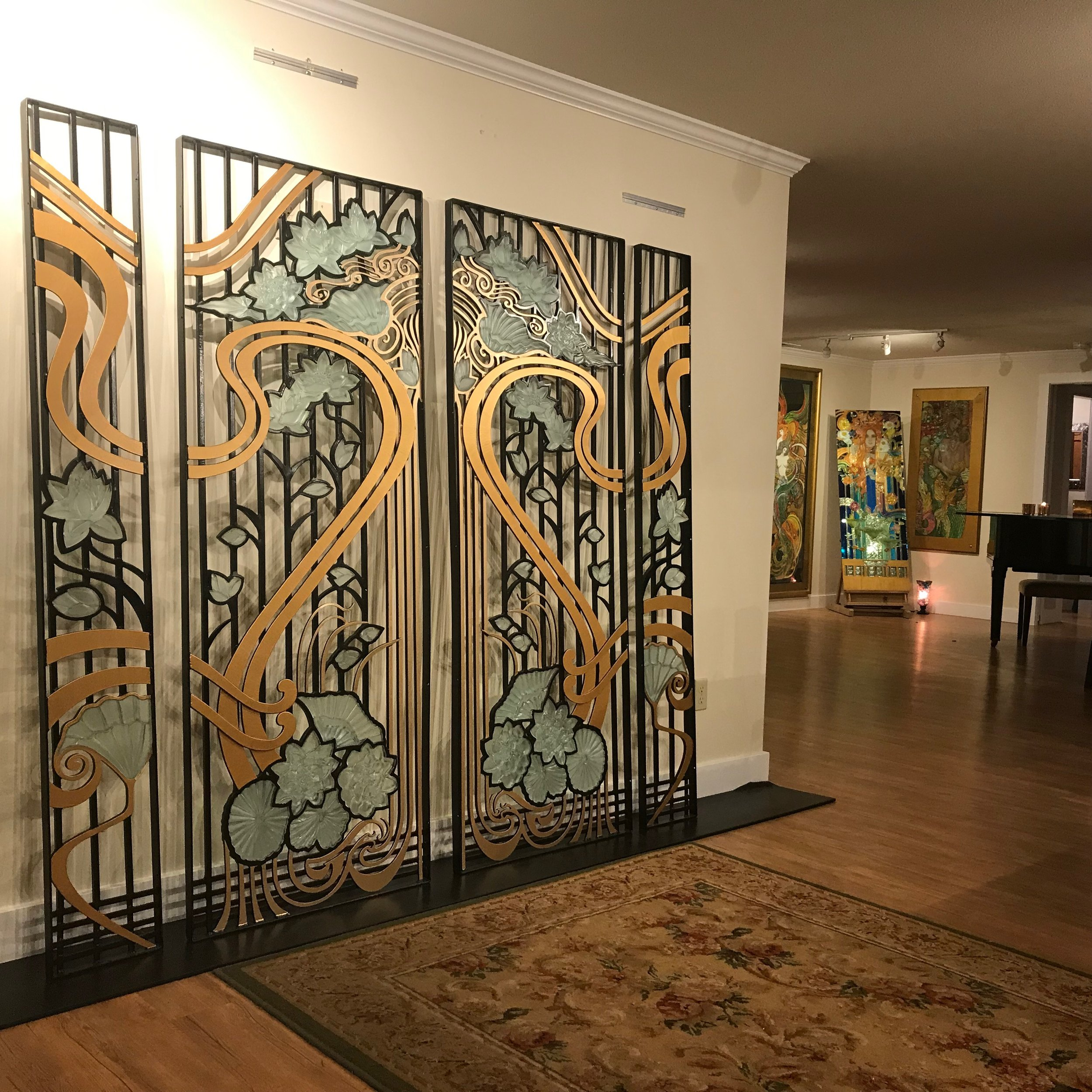 "iron & glass gate - Commission, 2018Wrought Iron and carved 3/4"" glass inserts with hand painted gold elements for custom home entry door.Original Design by Shannon"