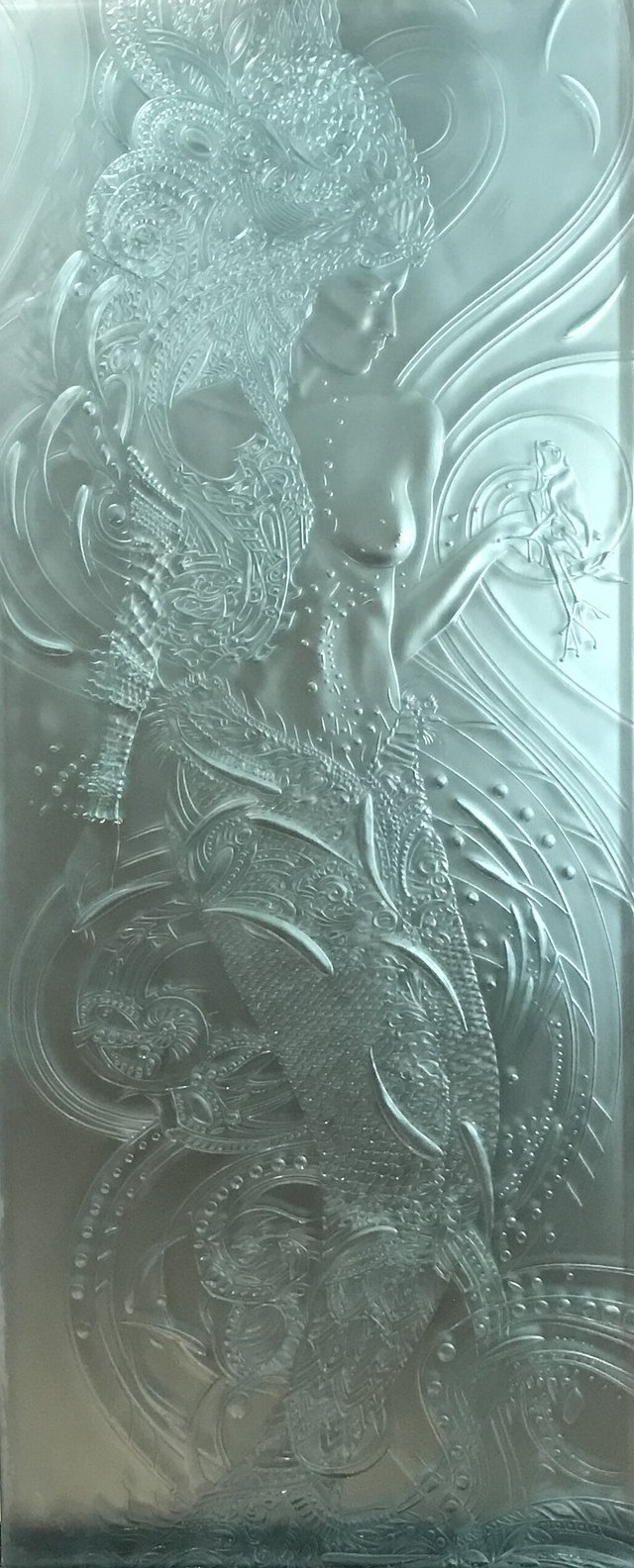"ibiza - Dimensions: 27""w x 66""h75 lbsCarved 3/4"" glassPicture unframedIbiza is a young mermaid warrior princess from the Mediterranean sea, with a frog who loves her. The glass in front of the printed image was carved by hand to accentuate elements of the underlying image. As light moves across the piece, the carved glass sparkles and shifts, adding a three dimensional element to the work."