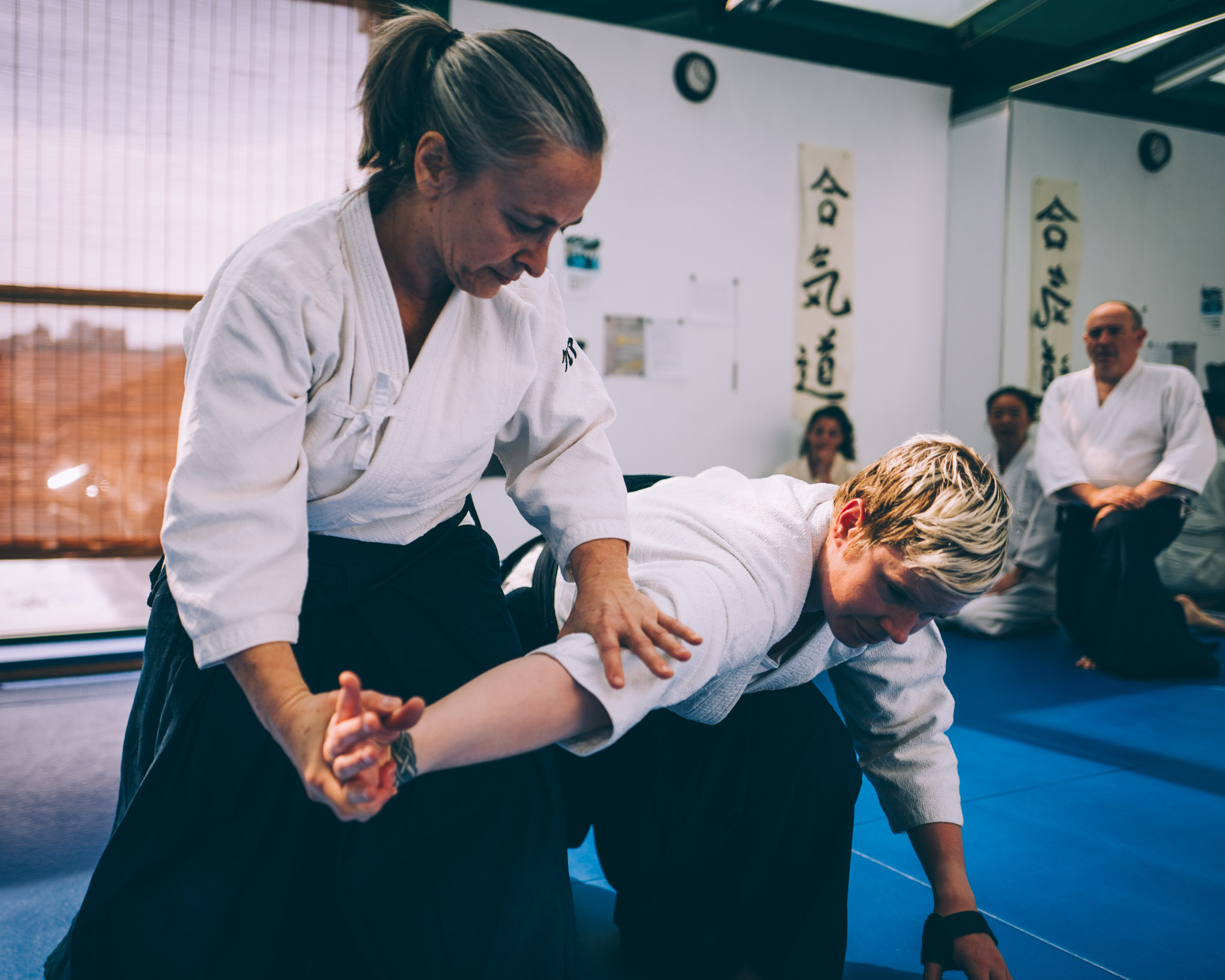 Claire Keller demonstrates nikkyo during an Aikido class at Bushwick Dojo in Brooklyn, New York
