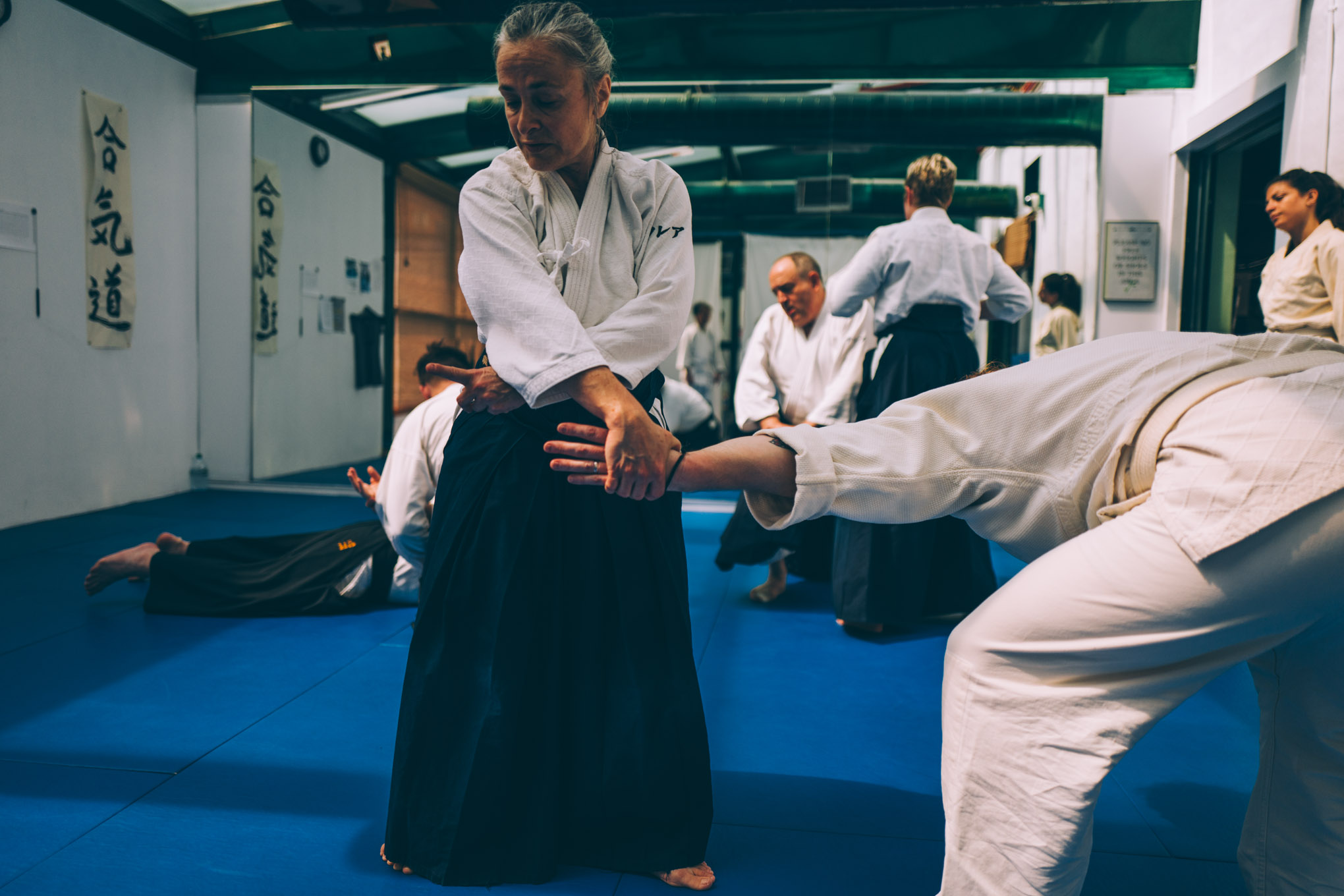 Claire Keller explains a technique during an Aikido class at Bushwick Dojo in Brooklyn, New York