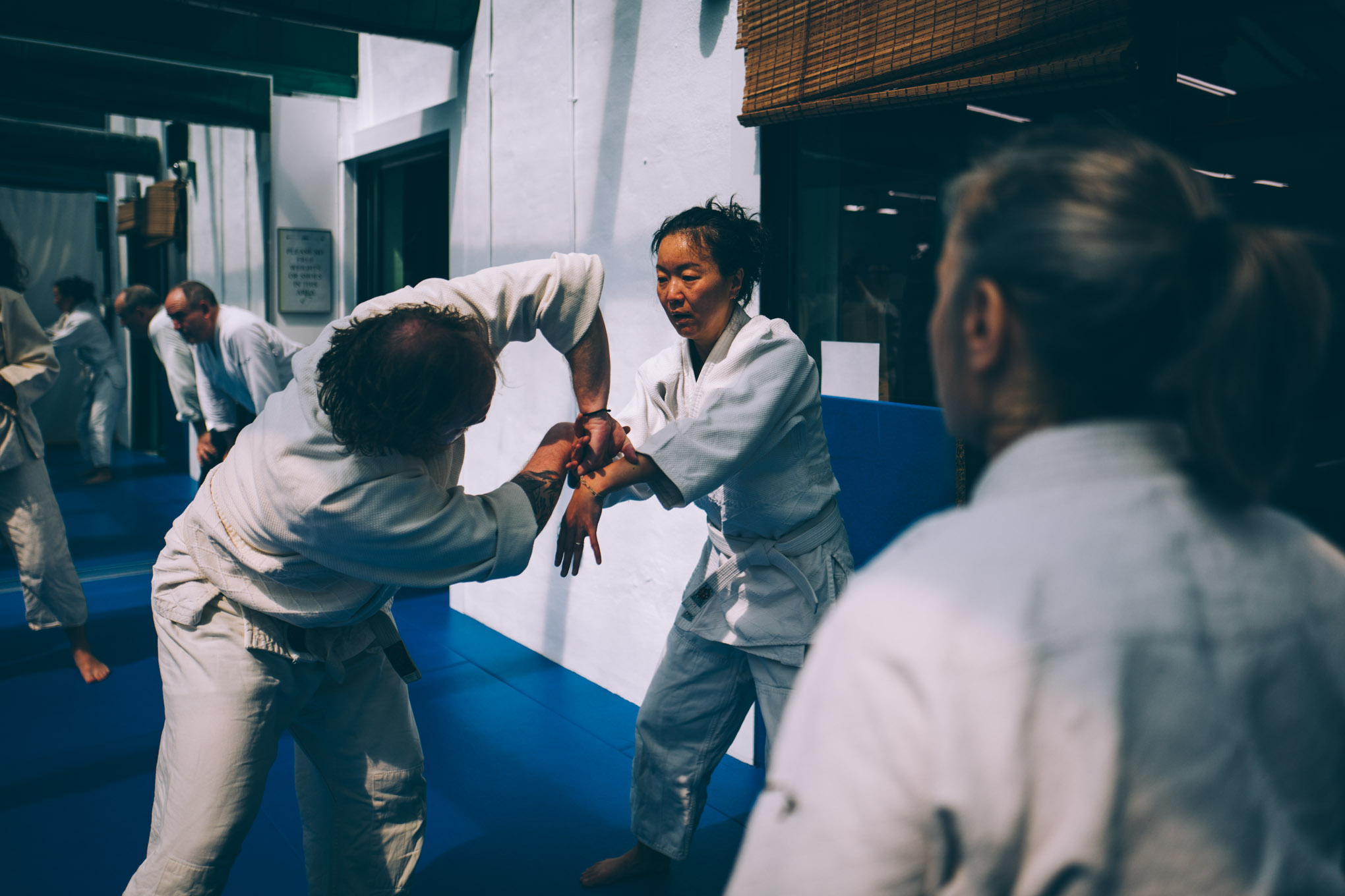 Claire Keller observes beginners practicing during an Aikido class at Bushwick Dojo in Brooklyn, New York