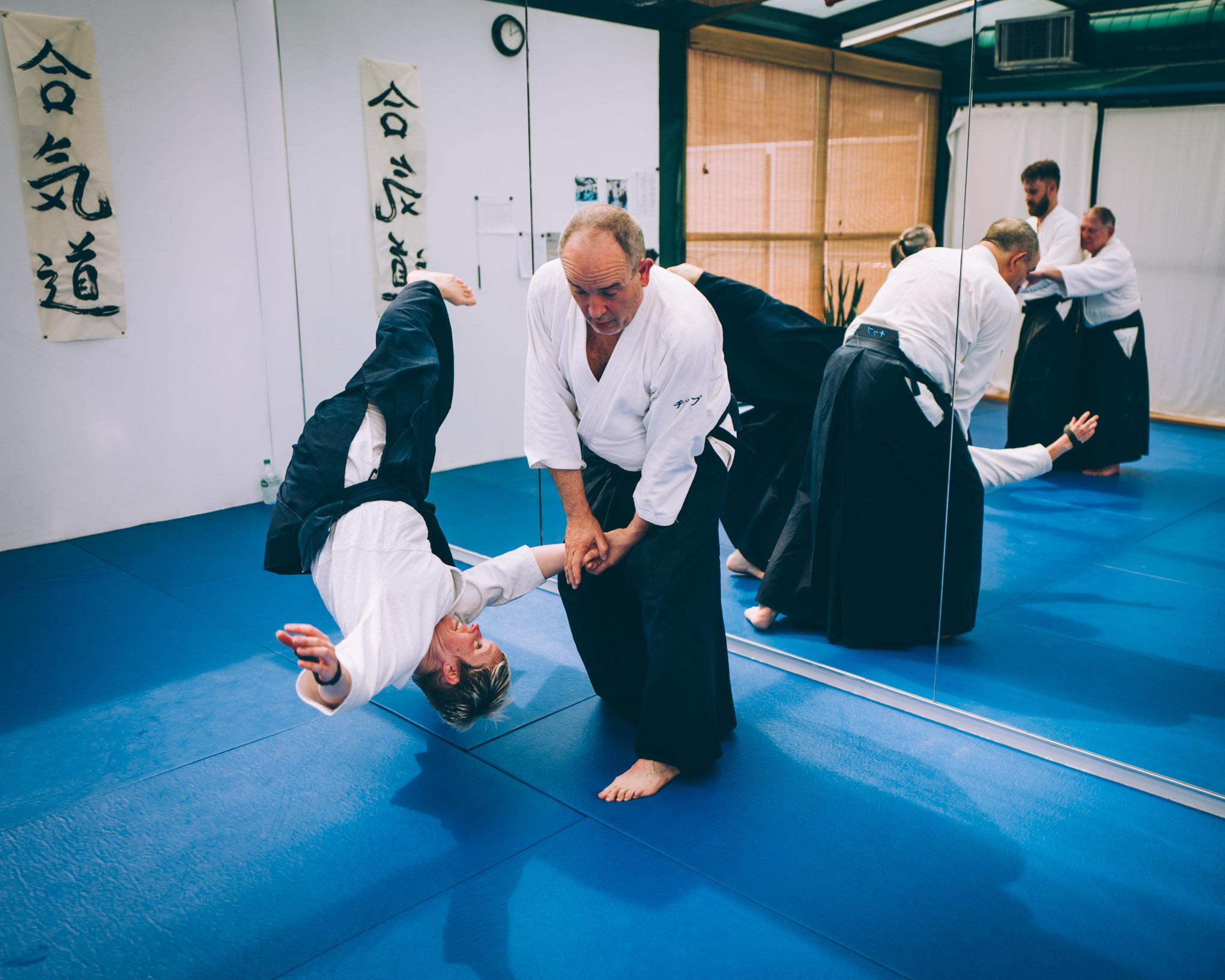 Two black belts practice kotegaeshi, a standard Aikido technique, at Bushwick Dojo in Brooklyn, New York