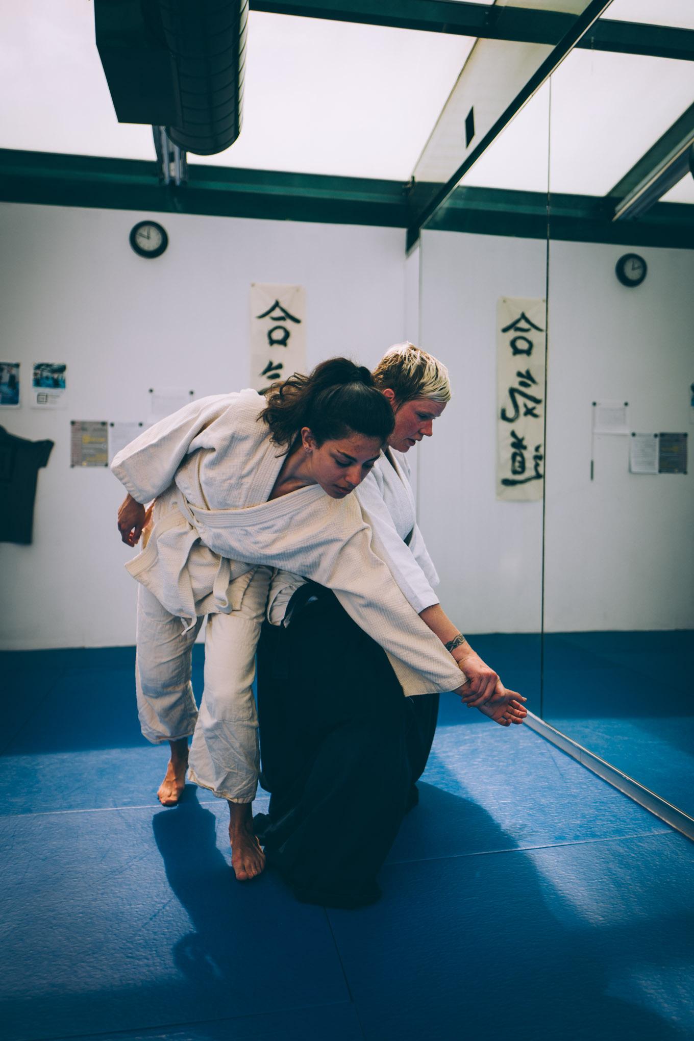 Gillian Macleod helps a beginner learn ukemi at Bushwick Dojo in Brooklyn, New York